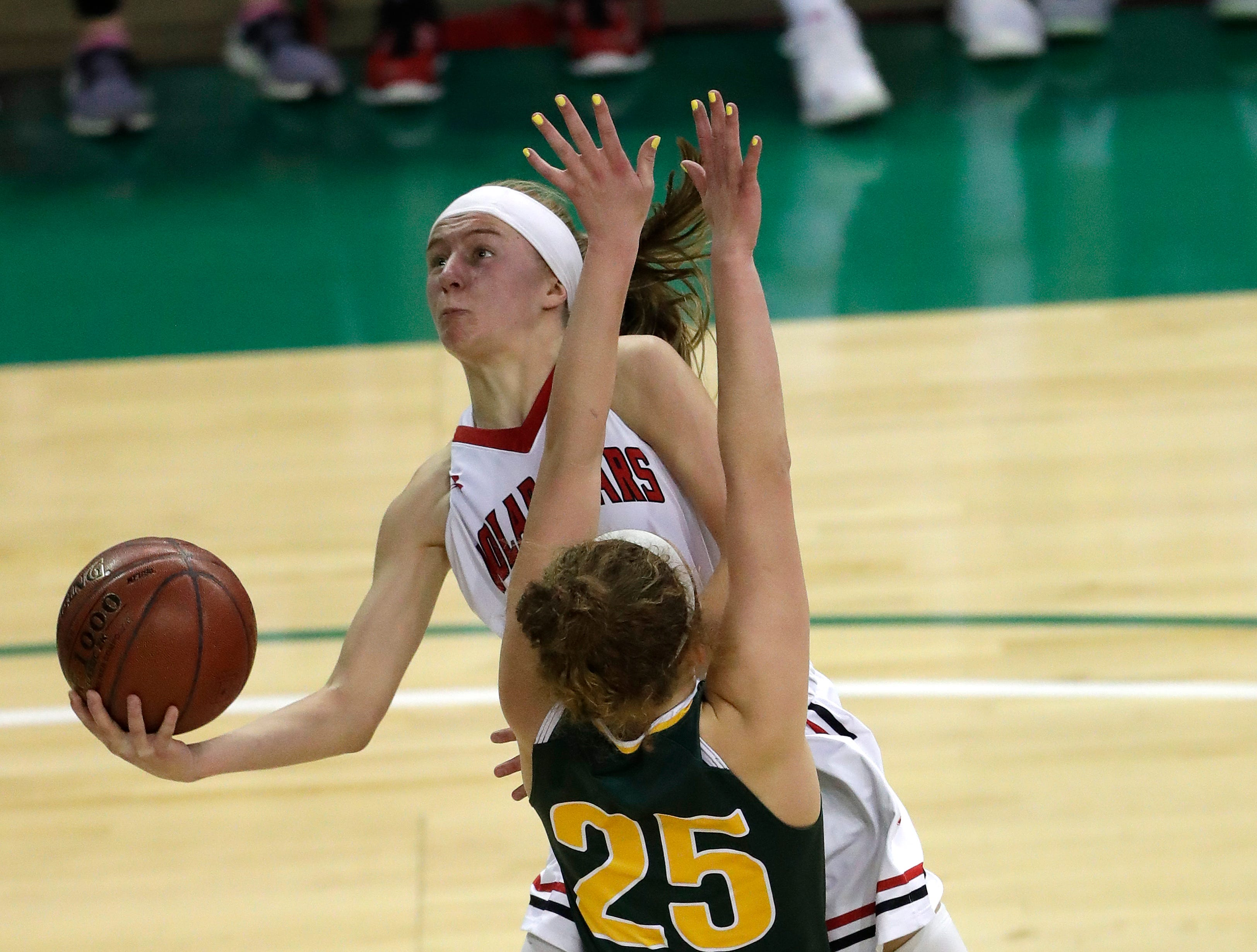 Hortonville's Kammy Peppler (23) puts up a shot against Beaver Dam's Matyson Wilke (25) during their Division 2 semifinal game at the WIAA girls state basketball tournament Friday, March 8, 2019, at the Resch Center in Ashwaubenon, Wis. Dan Powers/USA TODAY NETWORK-Wisconsin