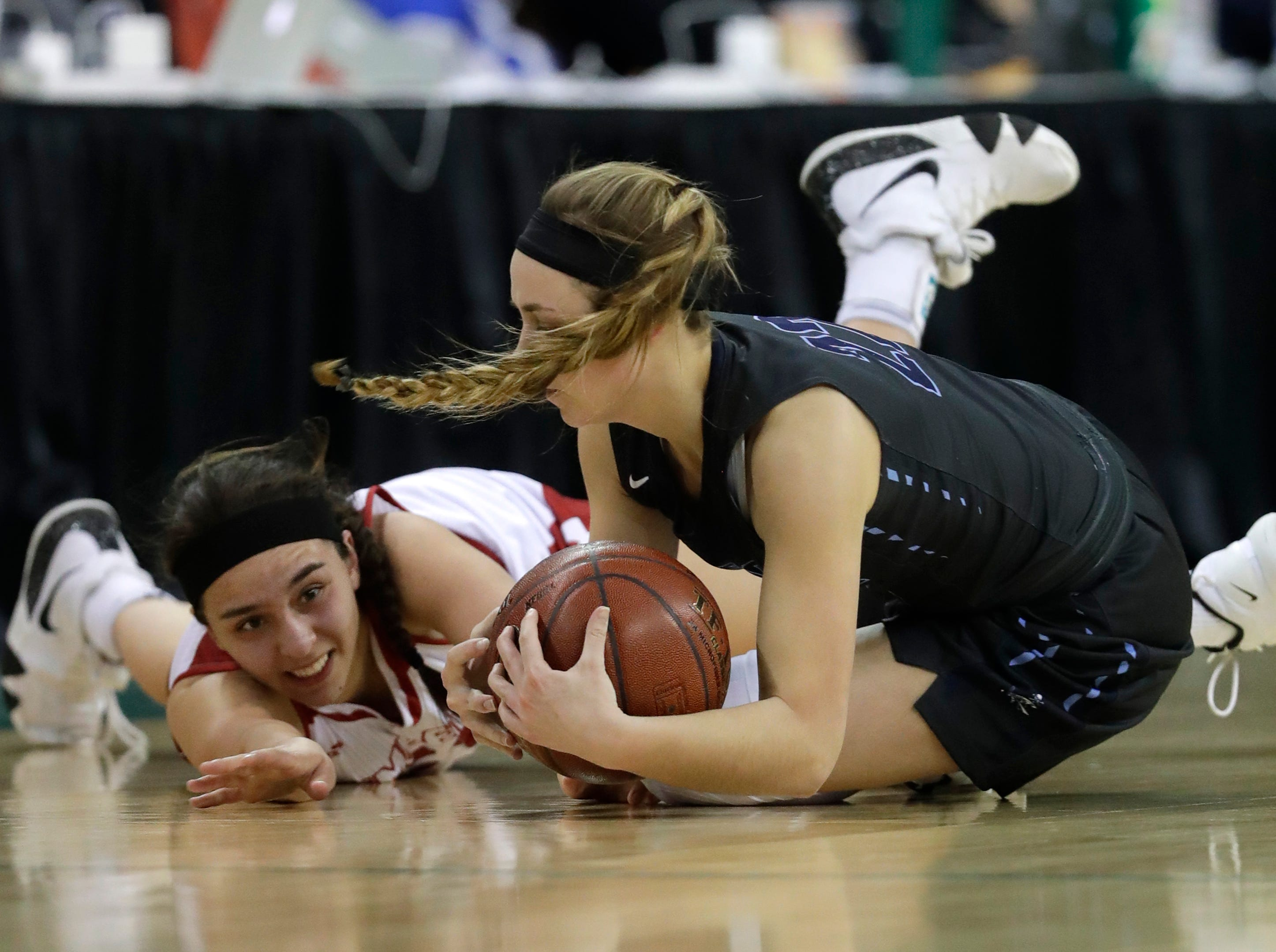 Kimberly's Shea Dechant (24) scrambles for a loose ball against Bay Port's McKenzie Johnson (22) during their Division 1 semifinal game at the WIAA girls state basketball tournament Friday, March 8, 2019, at the Resch Center in Ashwaubenon, Wis. Dan Powers/USA TODAY NETWORK-Wisconsin