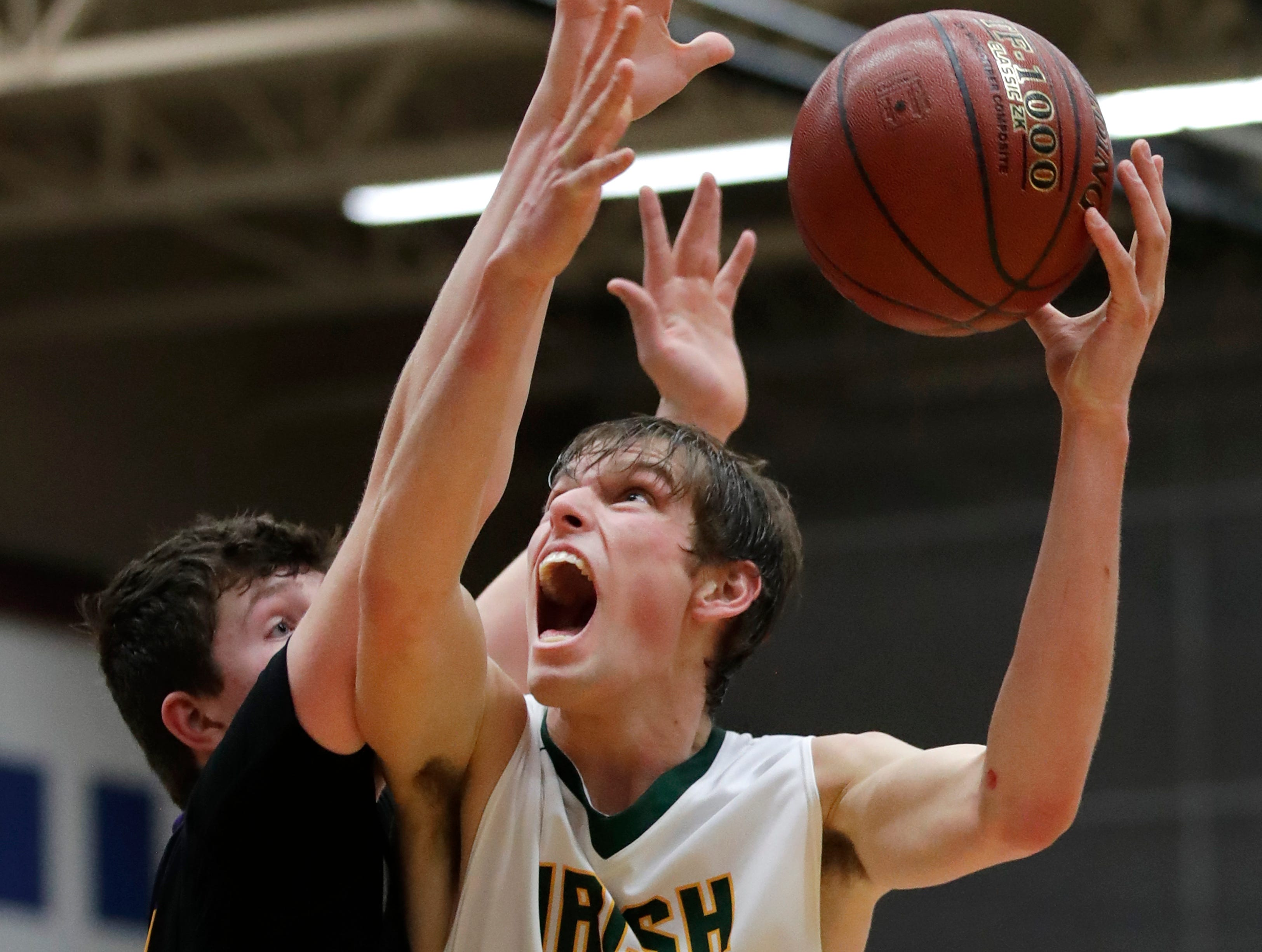 Freedom High SchoolÕs Luke Pingel pushes toward the basket against Denmark High School during the D3 sectional final Saturday, March 9, 2019, at Appleton North High School in Appleton, Wis.Danny Damiani/USA TODAY NETWORK-Wisconsin