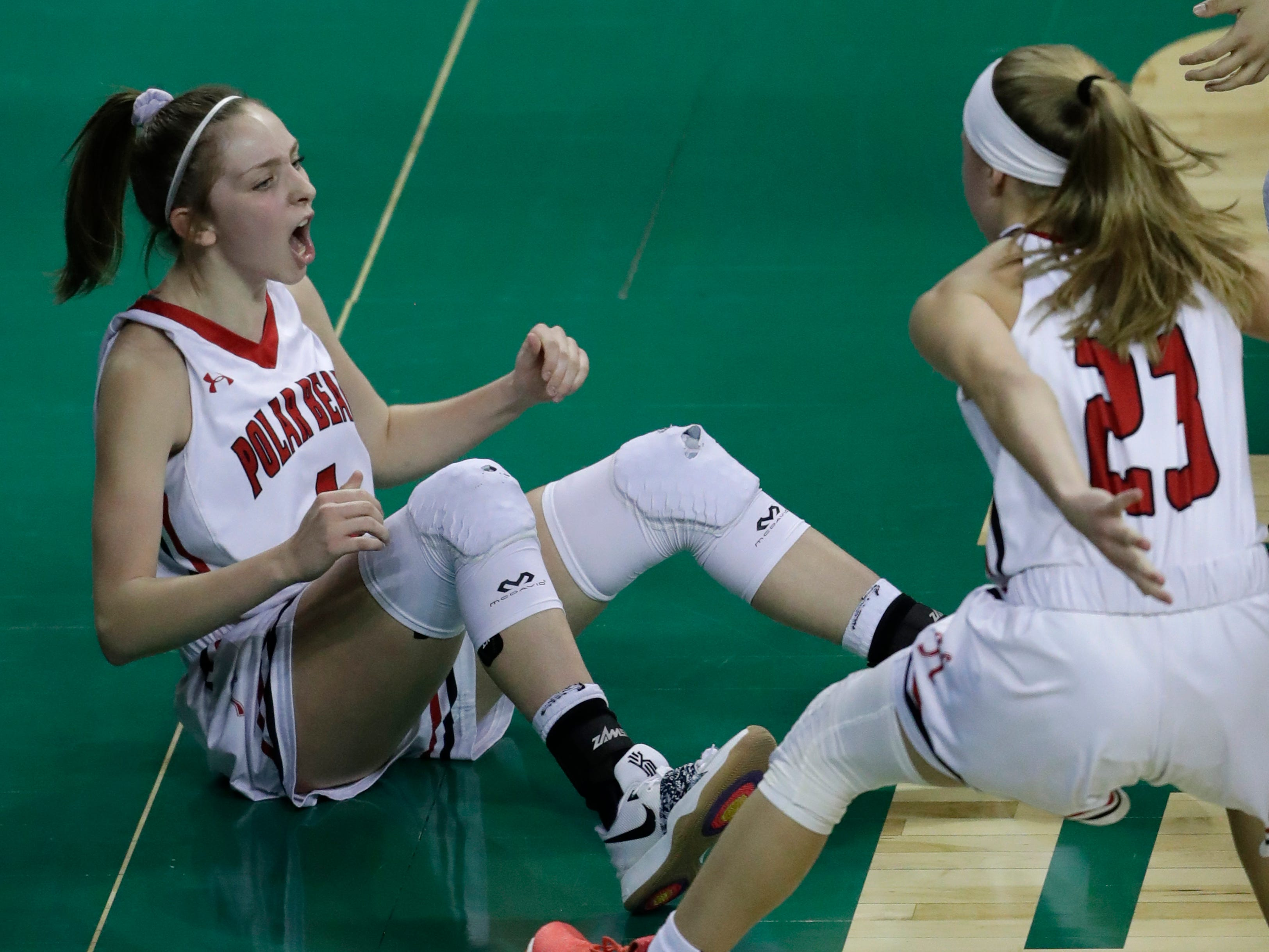 Hortonville's Lexi Day (4) celebrates scoring and getting fouled on the play with Kammy Peppler (23) against Beaver Dam during their Division 2 semifinal game at the WIAA girls state basketball tournament Friday, March 8, 2019, at the Resch Center in Ashwaubenon, Wis. Dan Powers/USA TODAY NETWORK-Wisconsin