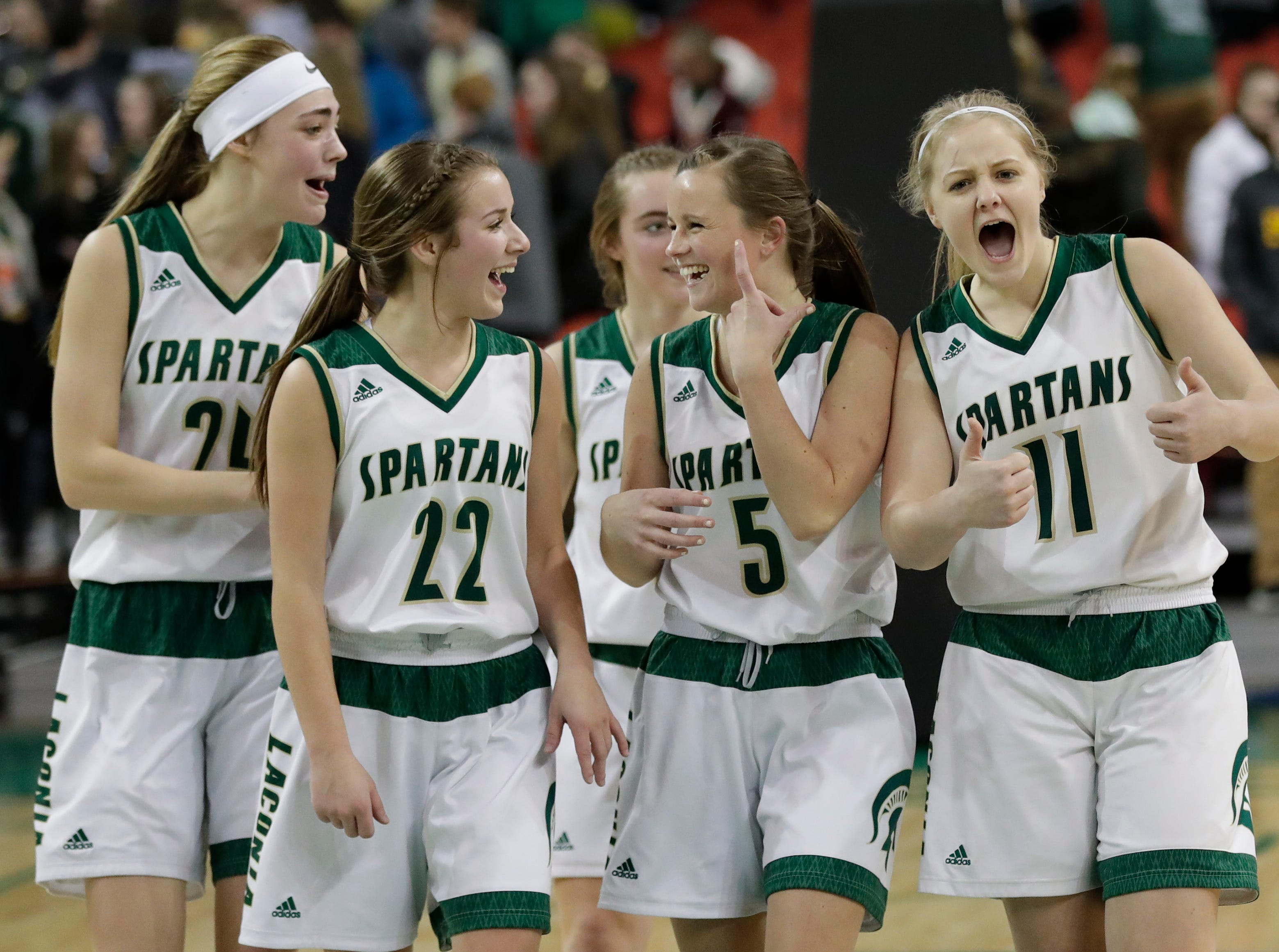 Laconia's Maci Grade (24), Haley Rens (22), Jen Beattie (5) Faith Weed (11) celebrate their 67-53 victory against Freedom during their Division 3 semifinal game at the WIAA girls state basketball tournament Thursday, March 7, 2019, at the Resch Center in Ashwaubenon, Wis. Dan Powers/USA TODAY NETWORK-Wisconsin