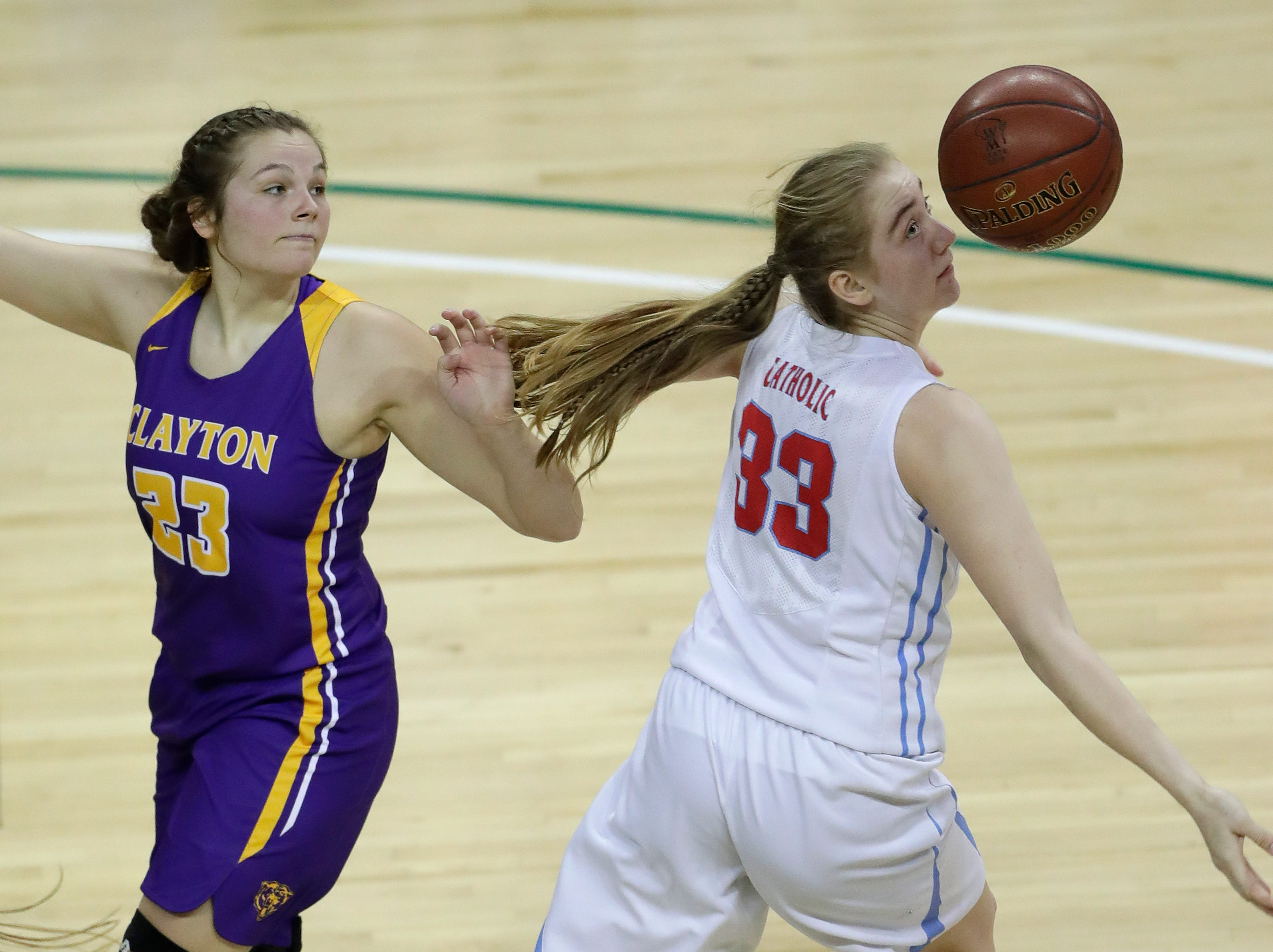 Clayton's Alison Leslie (23) defends against Wausau Newman Catholic's Jadelyn Ganski (33) during their Division 5 semifinal game at the WIAA girls state basketball tournament Friday, March 8, 2019, at the Resch Center in Ashwaubenon, Wis. Dan Powers/USA TODAY NETWORK-Wisconsin