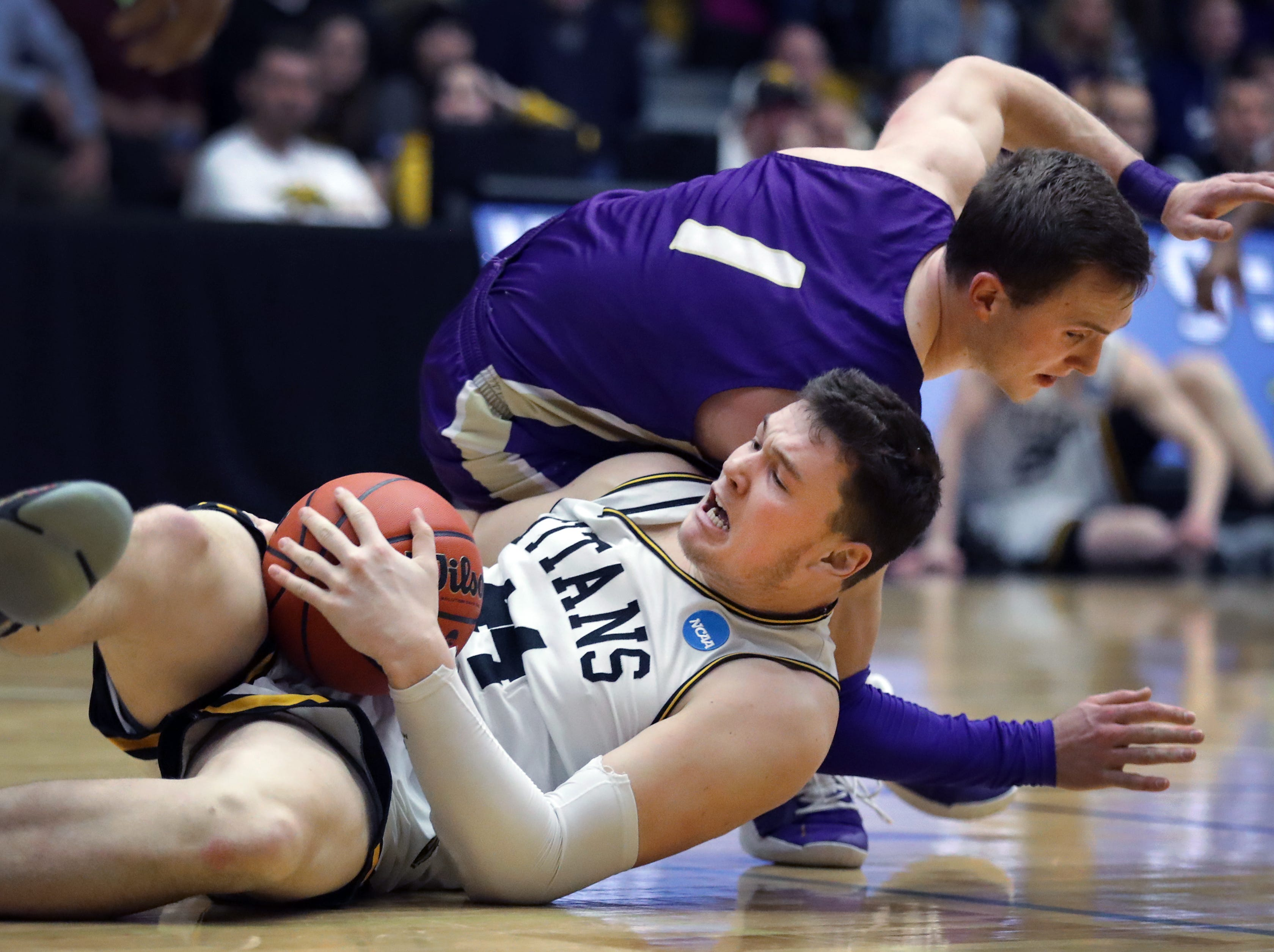 University of Wisconsin-Oshkosh's #44 Jack Flynn against Loras College-Iowa's #1 Ryan DiCanio during their NCAA DIII  Basketball Championship sectional game on Friday, March 8, 2019, at the Kolf Sports Center in Oshkosh, Wis. Oshkosh defeated Loras 86 to 75.Wm. Glasheen/USA TODAY NETWORK-Wisconsin.