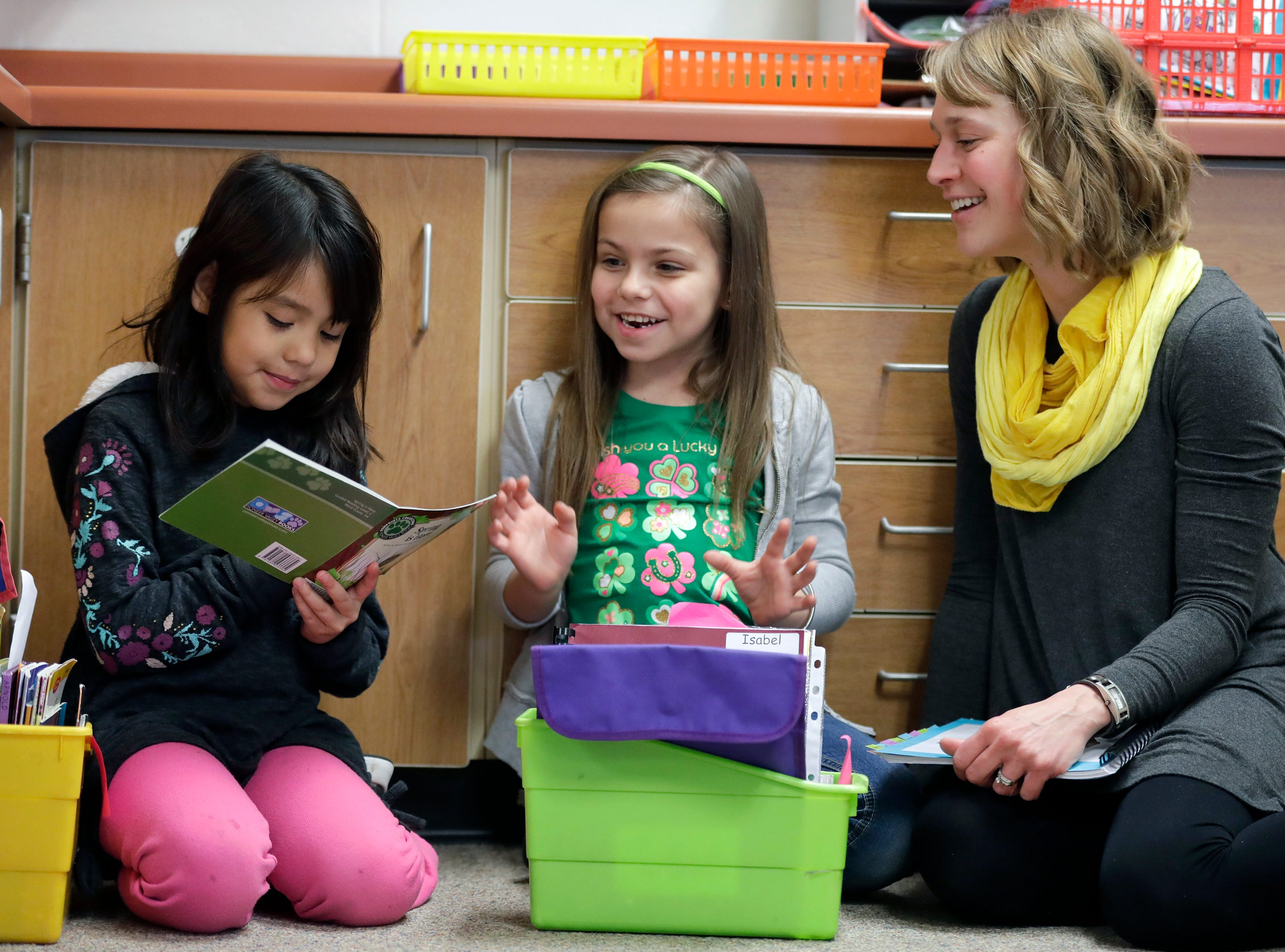 First grade students Stephanie Lopez Rivera, left, and Isabel Erdman participate in partner reading with the guidance of their teacher Emily Thomas Monday, March 4, 2019, at Horizons Elementary School in Appleton, Wis. Dan Powers/USA TODAY NETWORK-Wisconsin