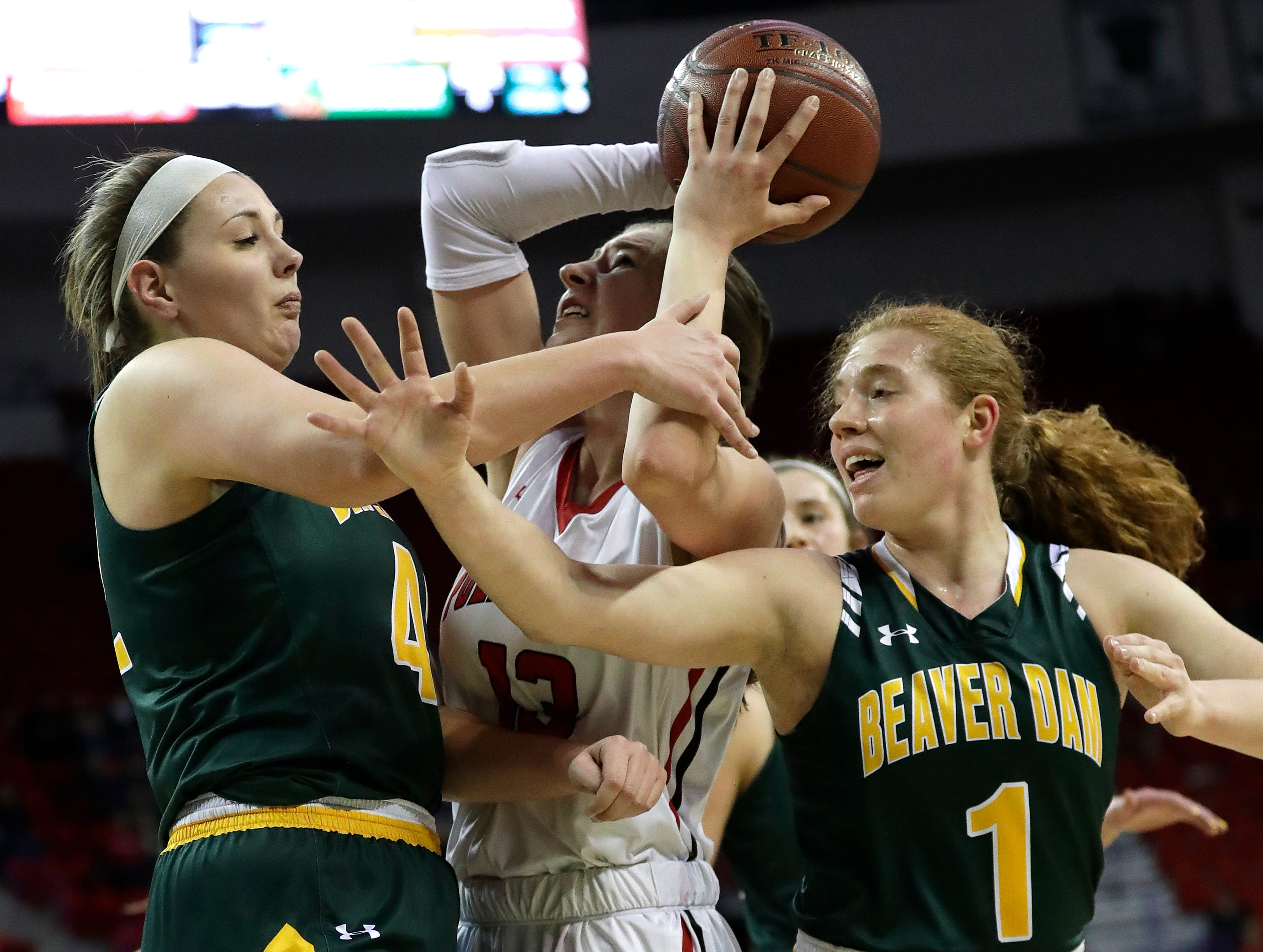 Hortonville's Macy McGlone (13) is fouled as she tries to put up a shot against Beaver Dam's Aly Van Loo (42) and Natalie Jens (1) during their Division 2 semifinal game at the WIAA girls state basketball tournament Friday, March 8, 2019, at the Resch Center in Ashwaubenon, Wis. Dan Powers/USA TODAY NETWORK-Wisconsin