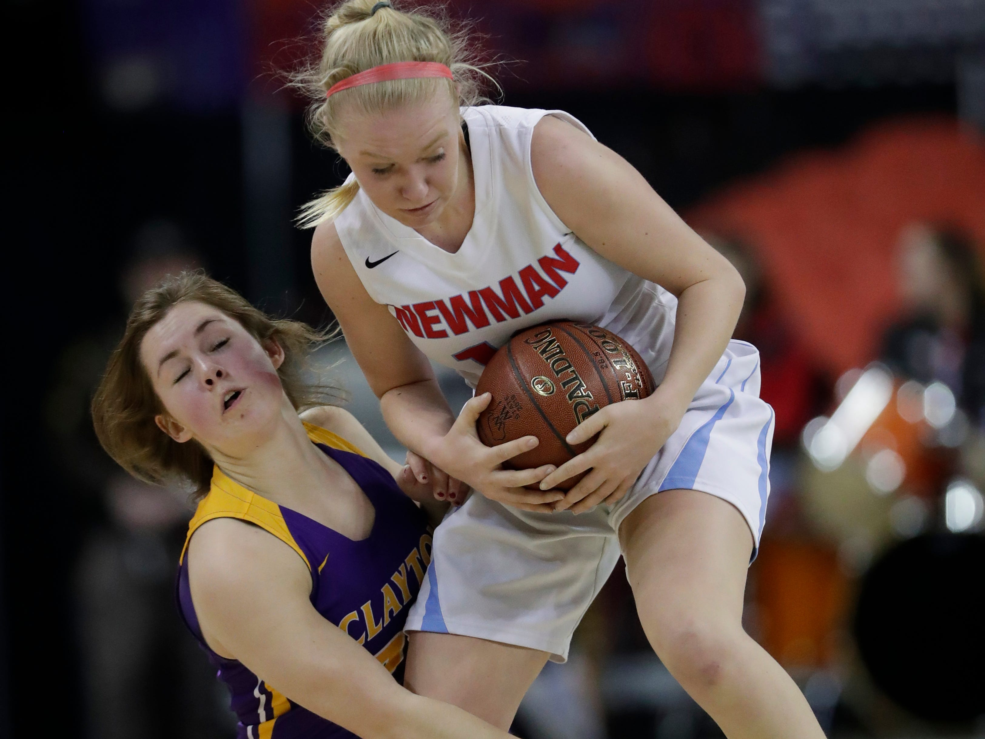 Clayton's Kailey Ketz (24) collides with Wausau Newman Catholic's Mackenzie Krach (12) during their Division 5 semifinal game at the WIAA girls state basketball tournament Friday, March 8, 2019, at the Resch Center in Ashwaubenon, Wis. Dan Powers/USA TODAY NETWORK-Wisconsin