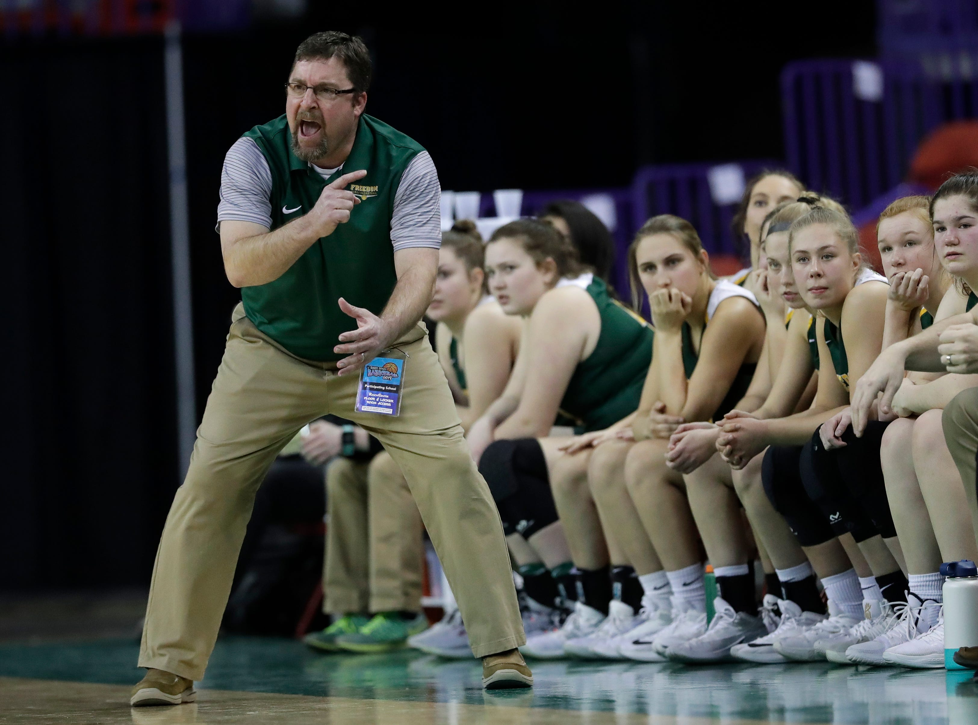 Freedom head coach Mike Vander Loop motivates his players against Laconia during their Division 3 semifinal game at the WIAA girls state basketball tournament Thursday, March 7, 2019, at the Resch Center in Ashwaubenon, Wis. Dan Powers/USA TODAY NETWORK-Wisconsin