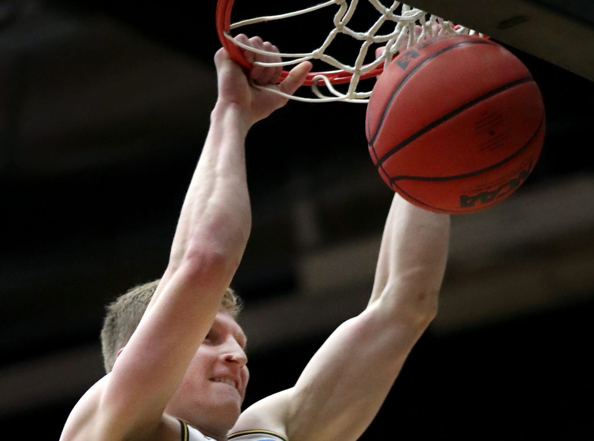 University of Wisconsin-Oshkosh's #20 Connor Duax dunks the ball in the first half against Loras College-Iowa during their NCAA DIII  Basketball Championship sectional game on Friday, March 8, 2019, at the Kolf Sports Center in Oshkosh, Wis. Oshkosh defeated Loras 86 to 75.Wm. Glasheen/USA TODAY NETWORK-Wisconsin.
