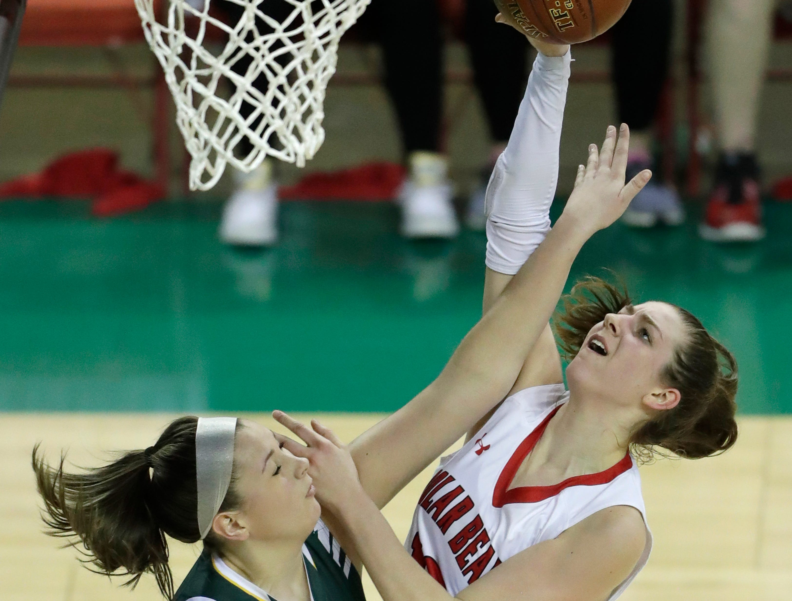 Hortonville's Macy McGlone (13) is fouled as she puts up a shot against Beaver Dam's Aly Van Loo (42) during their Division 2 semifinal game at the WIAA girls state basketball tournament Friday, March 8, 2019, at the Resch Center in Ashwaubenon, Wis. Dan Powers/USA TODAY NETWORK-Wisconsin