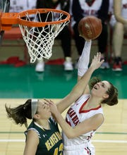 Hortonville's Macy McGlone (13) is fouled as she puts up a shot against Beaver Dam's Aly Van Loo (42) during their Division 2 state semifinal game.