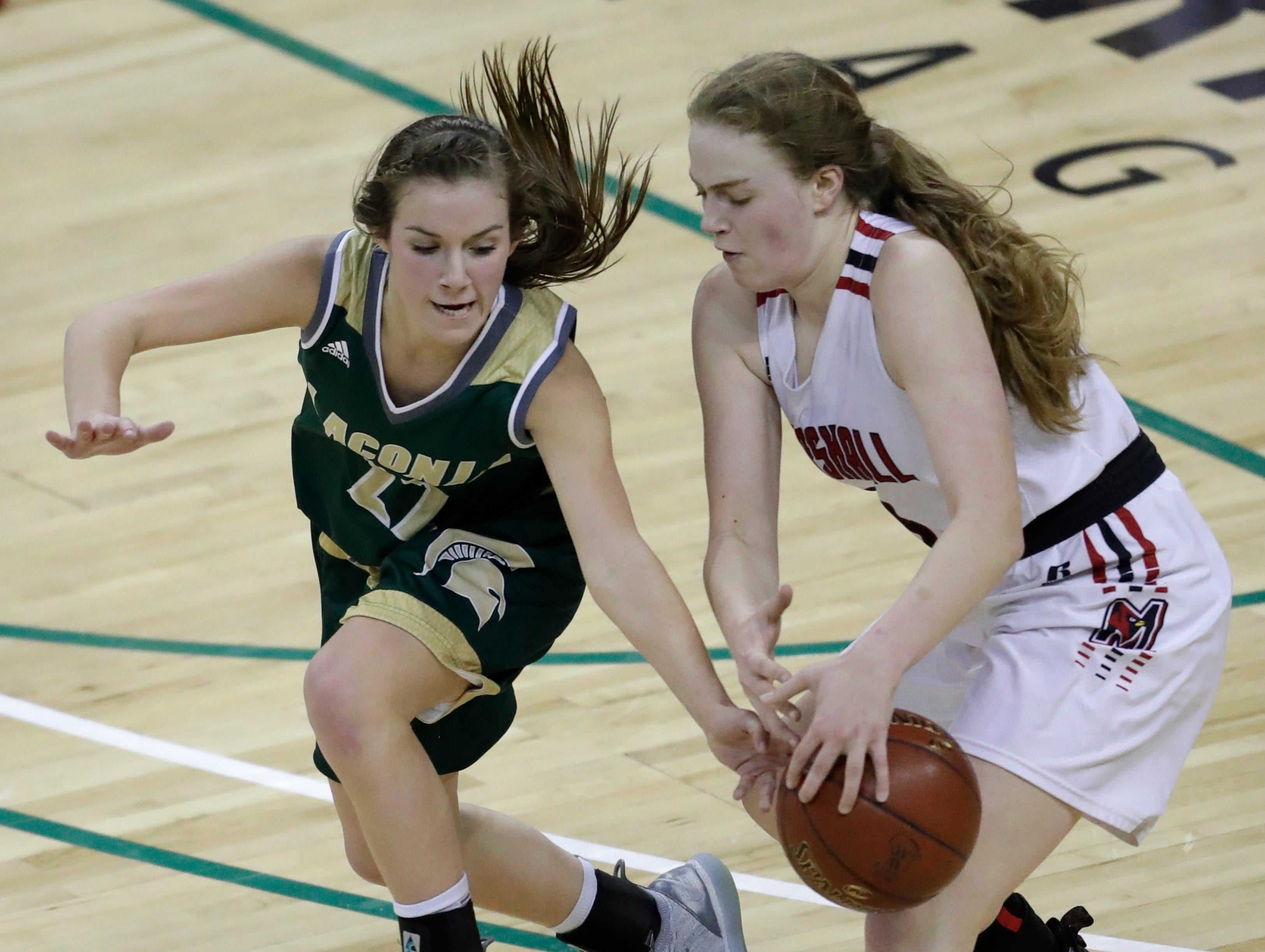 Laconia's Haley Rens (22) tries to steal the ball from Marshall's Anna Lutz (3) during their Division 3 championship game at the WIAA girls state basketball tournament Saturday, March 9, 2019, at the Resch Center in Ashwaubenon, Wis. Dan Powers/USA TODAY NETWORK-Wisconsin