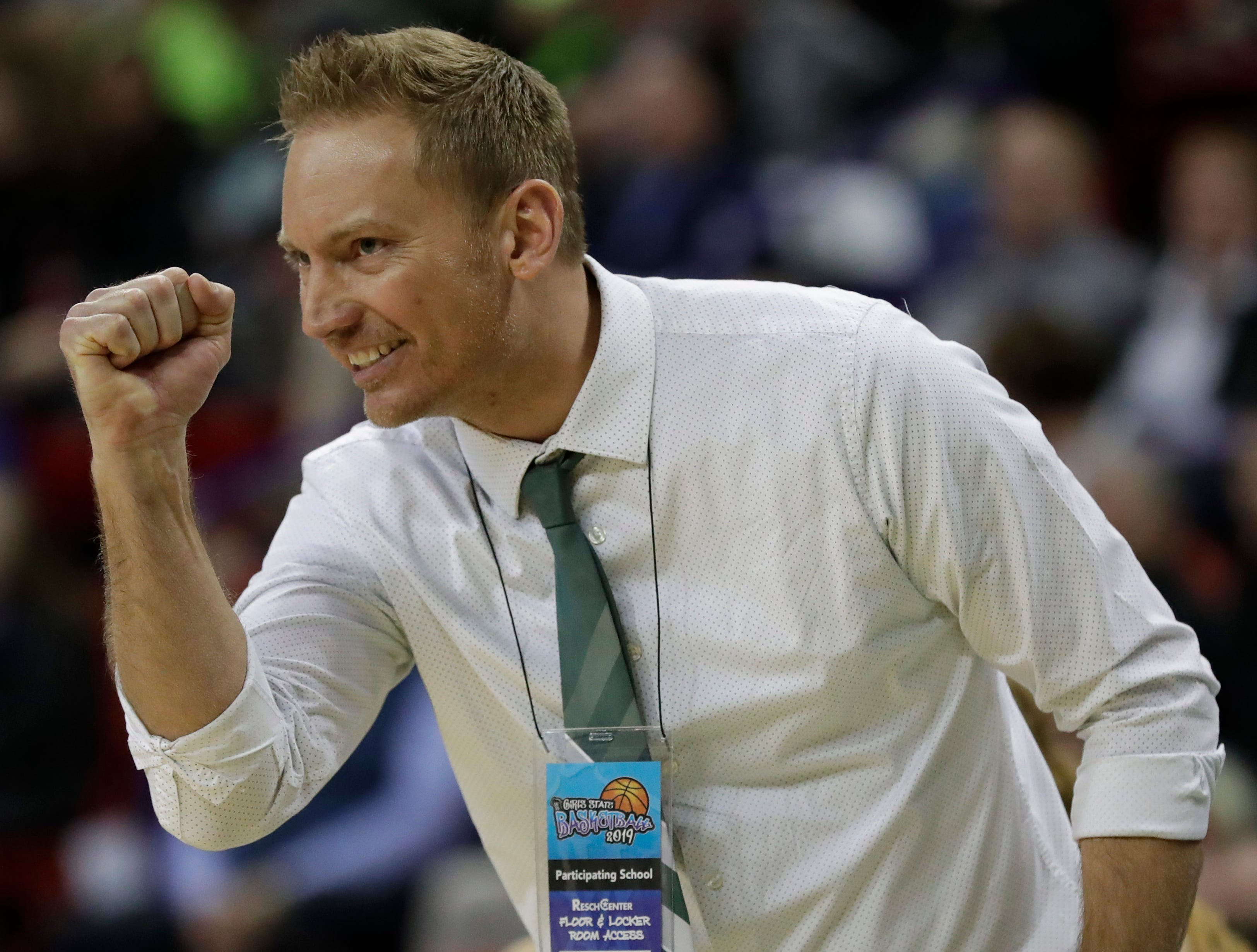 Laconia head coach Chris Morgan celebrates a basket scored late in the game against Freedom during their Division 3 semifinal game at the WIAA girls state basketball tournament Thursday, March 7, 2019, at the Resch Center in Ashwaubenon, Wis. Dan Powers/USA TODAY NETWORK-Wisconsin