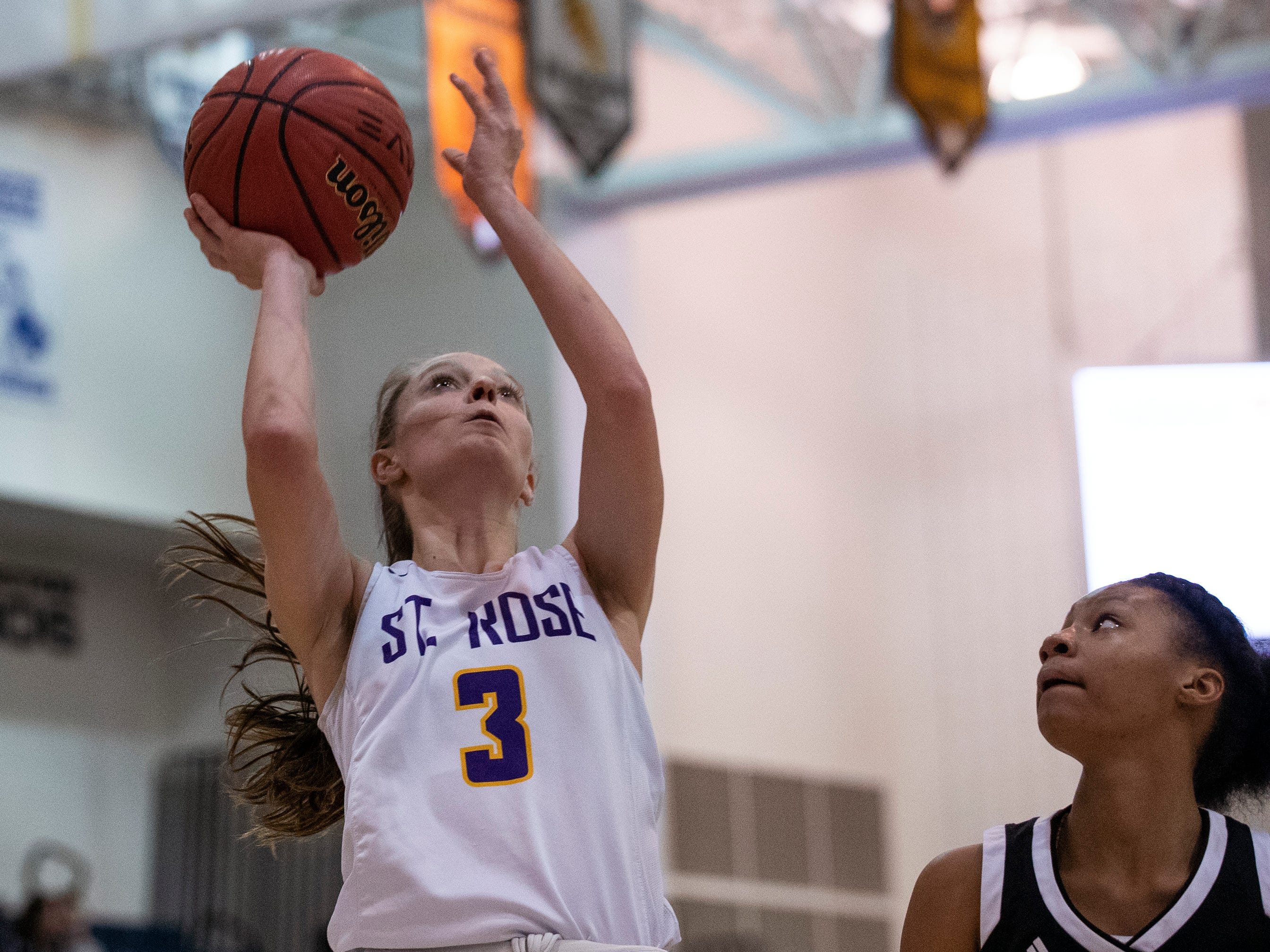 St. Rose's Lauren Lithgow goes up with a shot during first half action. St Rose Girls Basketball vs University in Tournament of Champions opening round game in Toms River on March 12, 2019