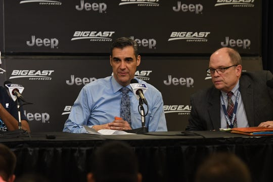 Jon Paquette (right) next to Villanova coach Jay wright during a Big East Tournament postgame press conference.