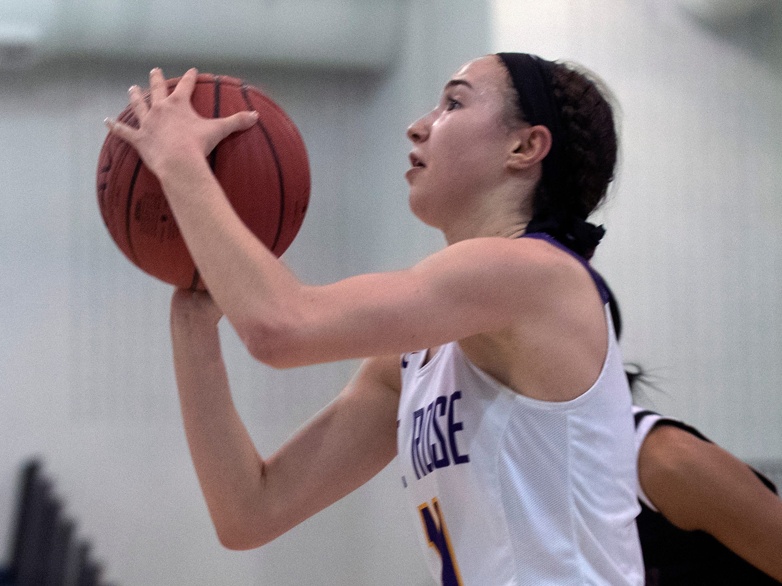 St.Rose's  Abigail Antognoli looks for an opening to shoot. St Rose Girls Basketball vs University in Tournament of Champions opening round game in Toms River on March 12, 2019.
