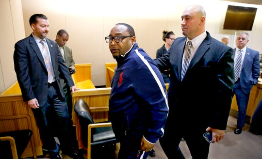 Michael Melton, Jonelle Melton's widower, leaves the State Superior Court courtroom where three men were found guilty of her murder Tuesday, March 12, 2019.