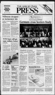 The Berlin Wall falls as the Cold War draws to a close, reuniting West and East Germans in jubilation in this edition from Friday, Nov. 10, 1989.