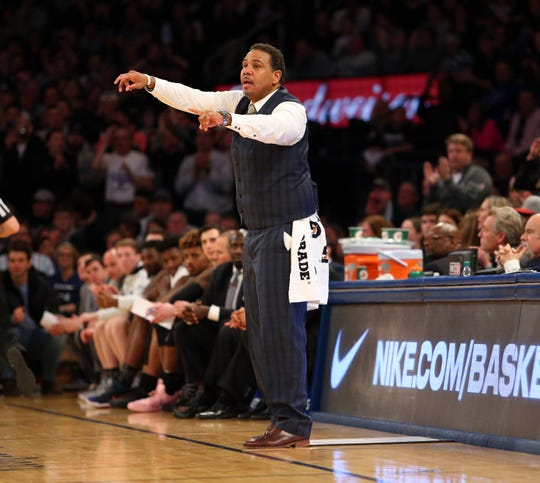 Providence Friars head coach Ed Cooley wears a towel around his waist after ripping his pants against Villanova in last year's final.
