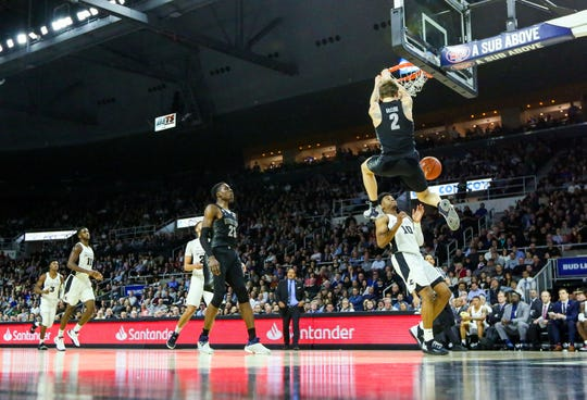 Georegtown Hoyas guard Mac McClung (2) dunks the ball against Providence