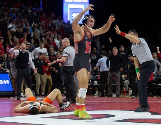 Rutgers' Joe Grello, shown after he defeated Princeton's Travis Stefanik in overtime on Feb. 13 in Rutgers' 19-18 win over Princeton, received an at-large bid to the NCAA Tournament Tuesday.