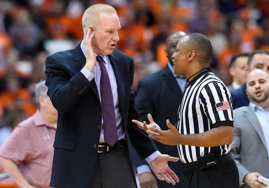 John's Red Storm head coach Chris Mullin talks with official Michael Stephens