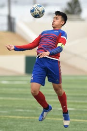 Cooper's Elvis Torres (4) settles the ball with his chest against Aledo at Shotwell Stadium on Monday, March 11, 2019. The Cougars won 3-1