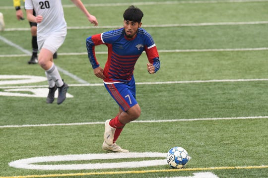 Cooper's Michael Rangel (7) looks to make a pass against Aledo at Shotwell Stadium on Monday, March 11, 2019. Rangel had two goals and an assist as the Cougars won 3-1.
