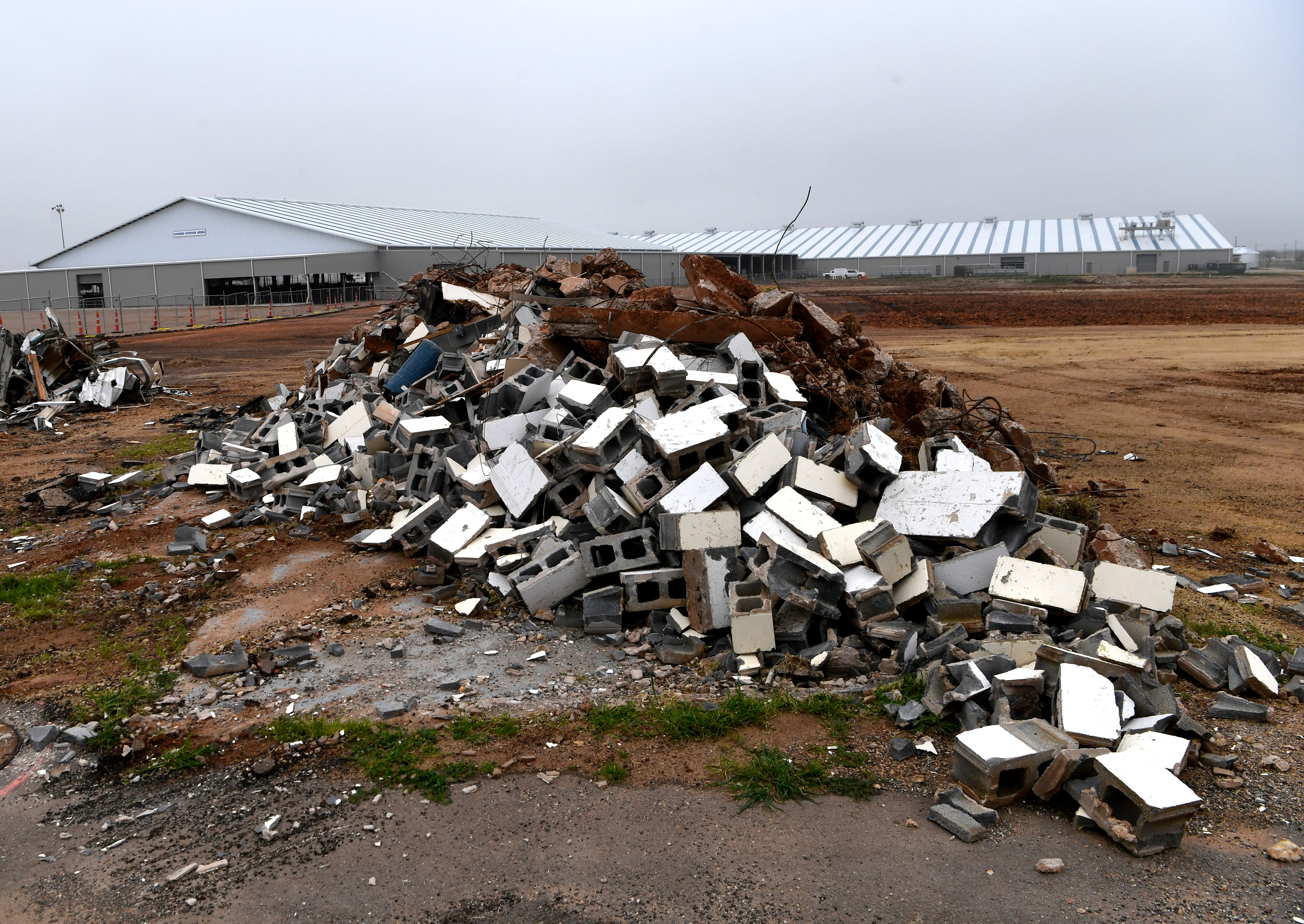 Debris is mounded on a construction site at the Taylor County Expo Center on March 12. In the background is the Covered Arena and the new Livestock Barn, which opened in 2018.