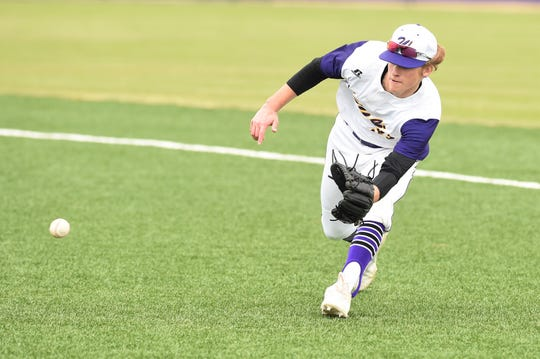 Wylie second baseman Tyler Martin (31) fields a ground ball against Aledo at Bulldog Field on Tuesday, March 12, 2019. Martin had a hit and an RBI in Wylie's 8-5 loss.
