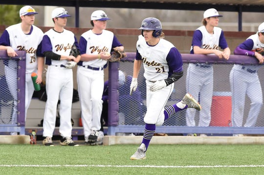 Wylie's Cooper Cothran (21) runs down the third base line and scores against Aledo at Bulldog Field on Tuesday, March 12, 2019. Cothran made a diving play in right field, had two hits, scored two runs and got the final five outs in a scoreless relief appearance.