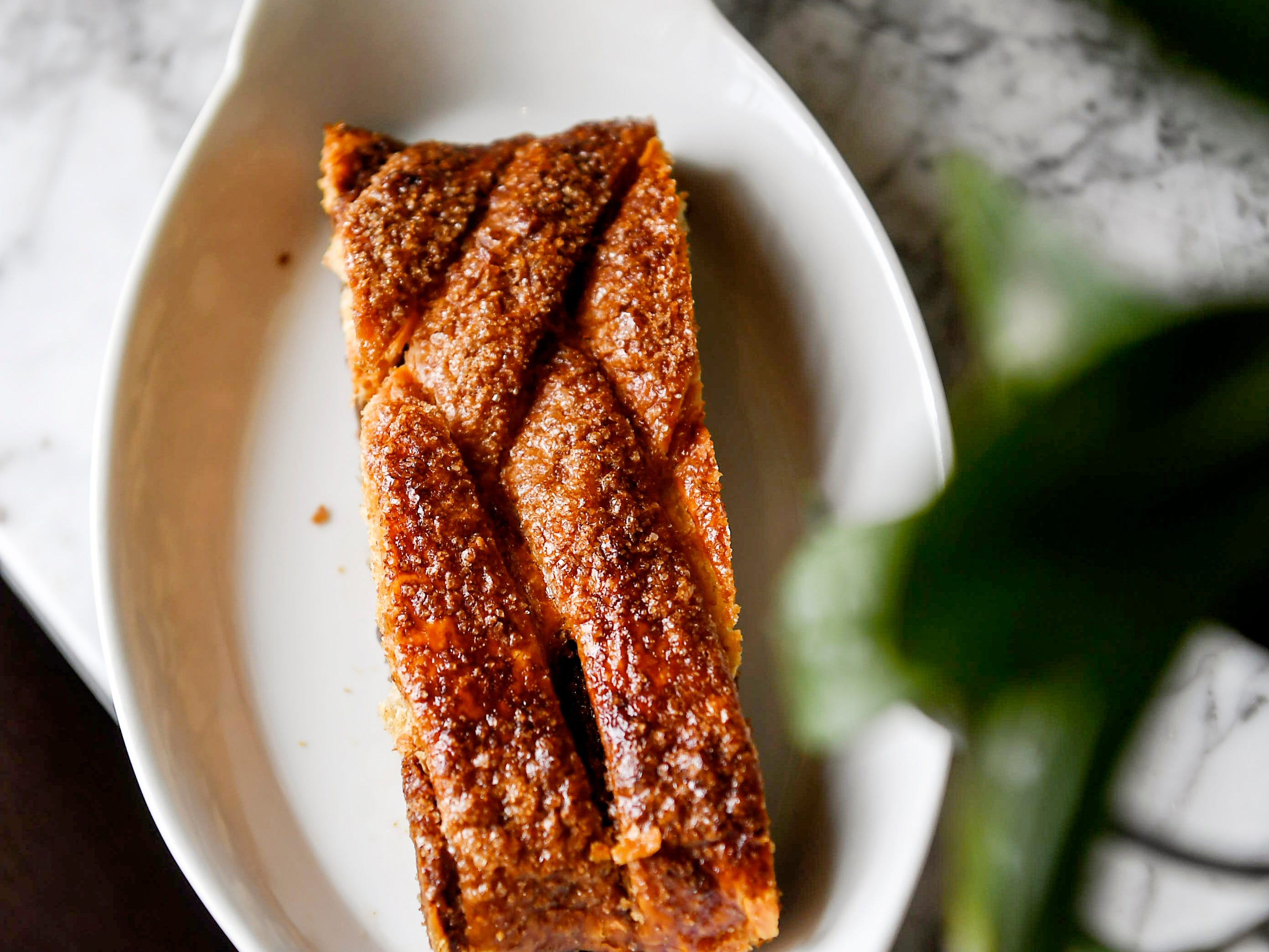 The walnut strudel at OWL Bakery has a thick dense filling of finely ground walnuts, sugar and warm spices of cinnamon and clove, all surrounded by a dark-golden, crisp and flaky pastry.