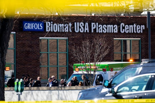 Swarms of police respond to Grifols Biomat USA Plasma Center on reports of shots fired in downtown Kalamazoo, Michigan on Tuesday. Authorities say a police officer has been shot while responding to the shooting.