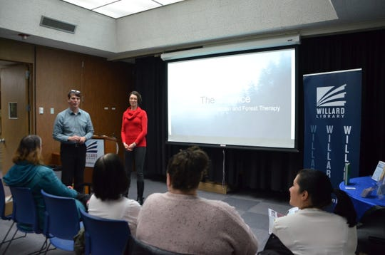 Matt Willis of Willard Library introduces Forest Therapy Guide Cayla Samano ahead of her presentation as part of the library's 'Love Where You Live' campaign on Feb. 27, 2019.