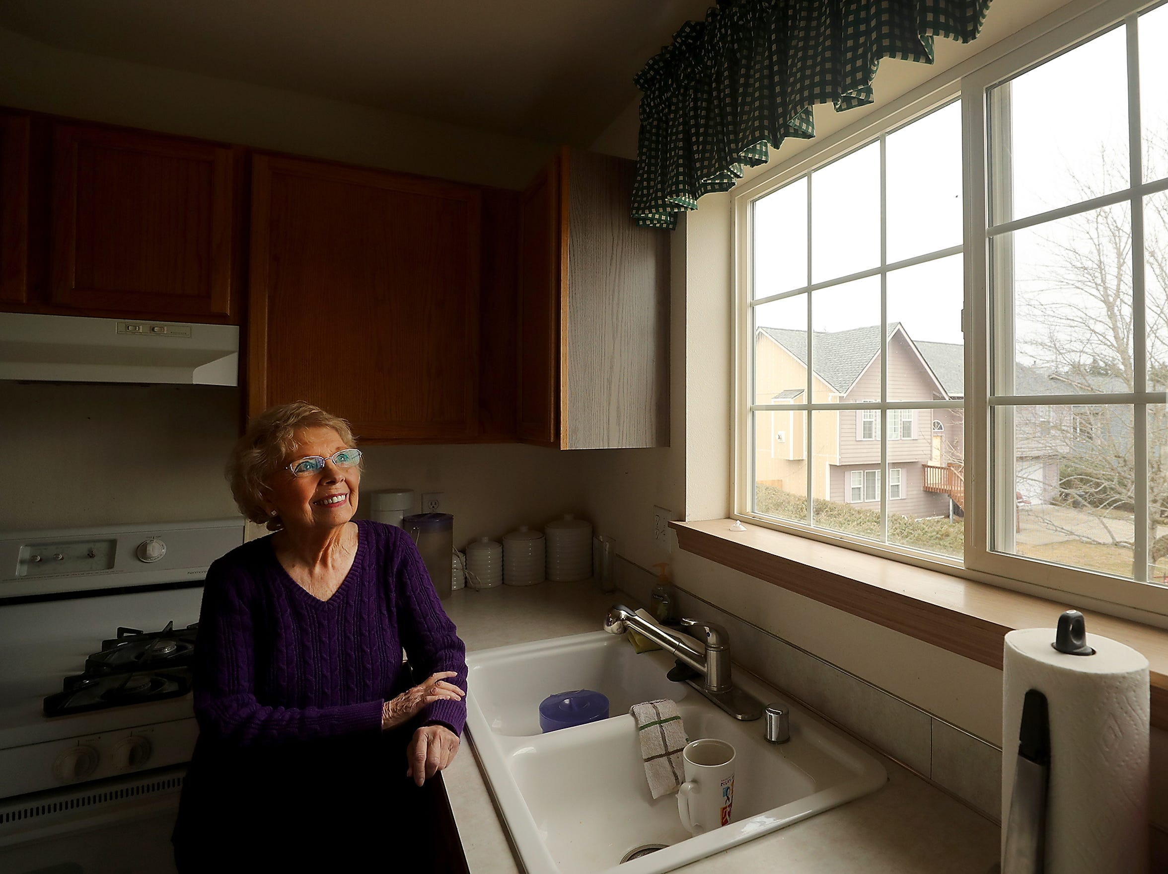 Mary Ann Huntington stands in the recently repaired kitchen of her Tiburon Court home in Port Orchard.