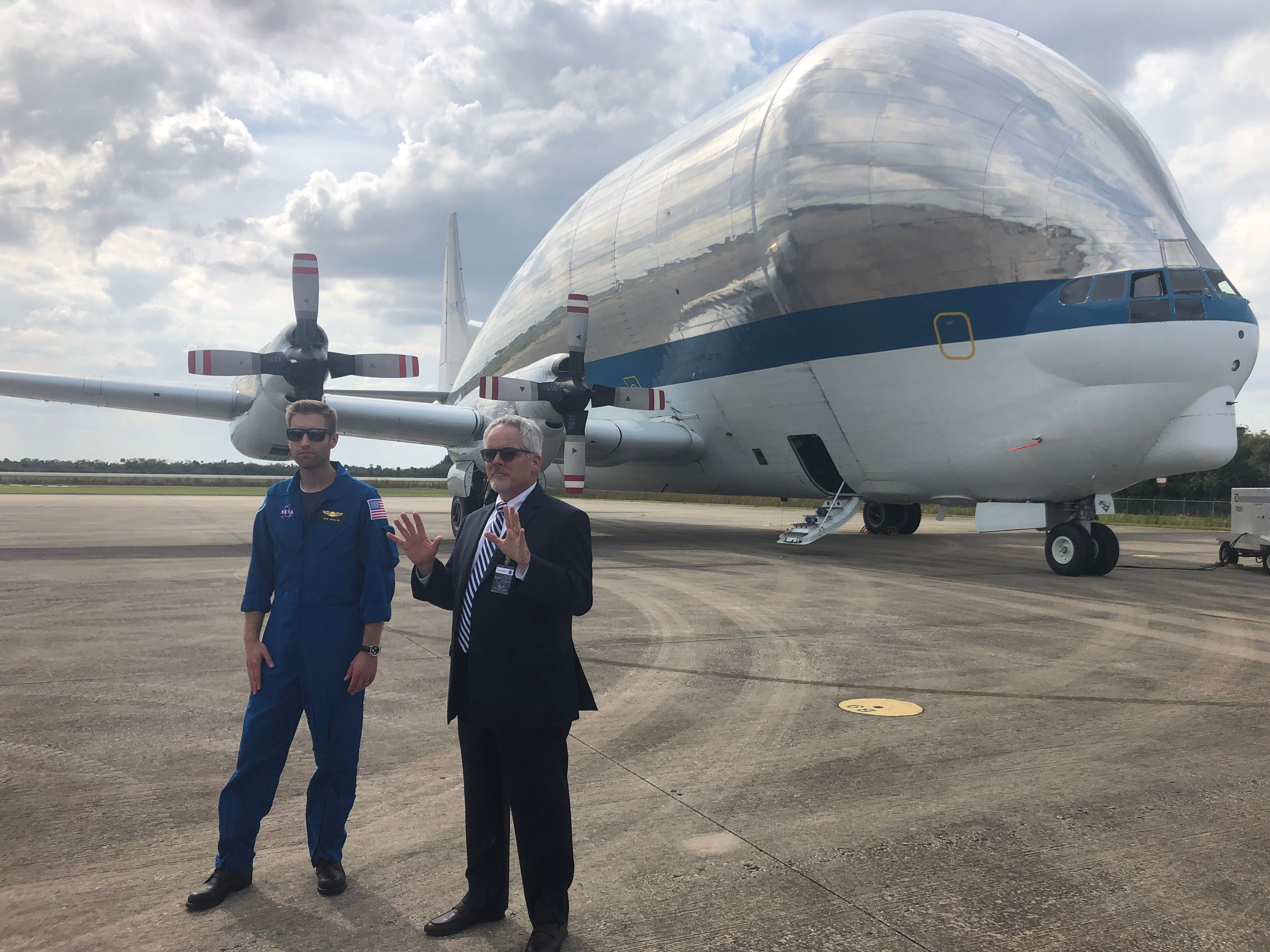 Super Guppy program manager John Bakalyar and Orion Production Operations Chief of Spacecraft Systems Test Capabilities Mike See explain how NASA's Super Guppy plane will transport Orion spacecraft to Ohio for testing in July.