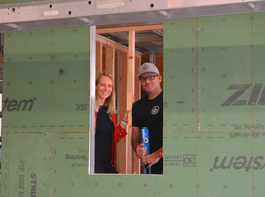 Mike and Nikki Cheatham were looking to downsize in 2017 and started looking at tiny houses as customers. Their search turned into a successful business - Movable Roots - making small homes for others. Mike and Nikki standing inside their custom Wansley model that is 36 feet long.