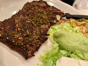 Arrachera was a sizeable slice of marinated, grilled skirt steak with a fair amount of kick.