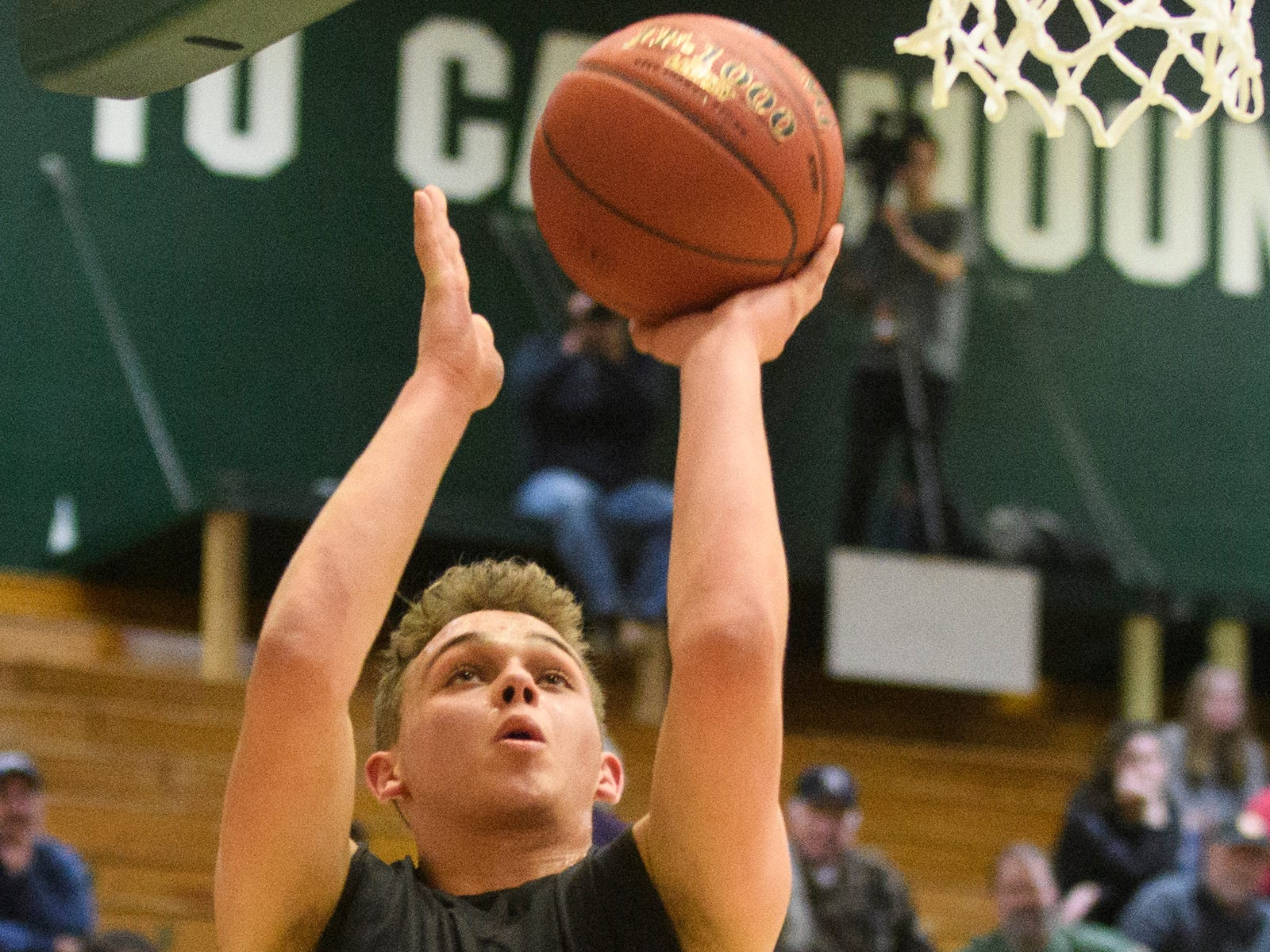 Rutland's Ethan Notte (15) leaps for a lay up during the boys DI semi final basketball game between the Rutland Raiders and the Mount Mansfield Cougars at Patrick Gym on Monday night March 11, 2019 in Burlington, Vermont.