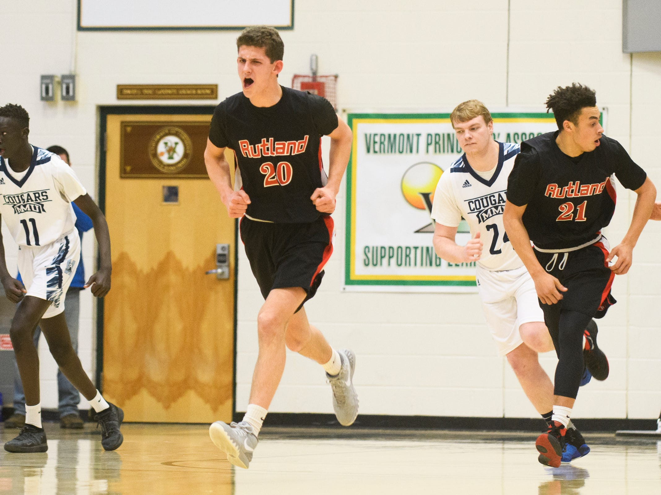 Rutland's Eric Coughlin (20) celebrates a three pointer during the boys DI semi final basketball game between the Rutland Raiders and the Mount Mansfield Cougars at Patrick Gym on Monday night March 11, 2019 in Burlington, Vermont.