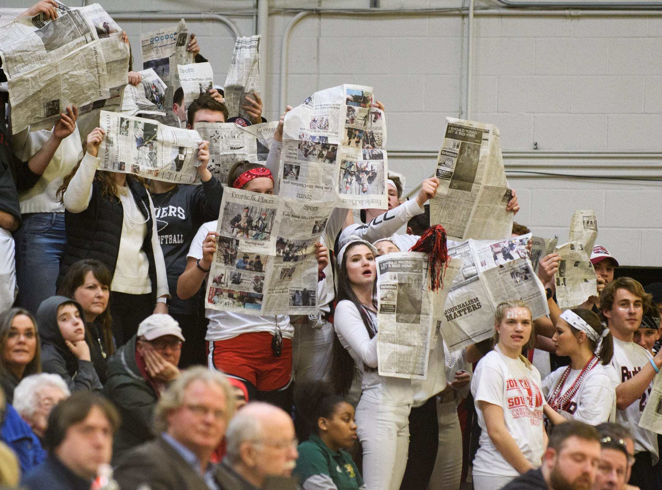 Rutland fans hold p newspapers during a MMU free throw attempt during the boys DI semi final basketball game between the Rutland Raiders and the Mount Mansfield Cougars at Patrick Gym on Monday night March 11, 2019 in Burlington, Vermont.
