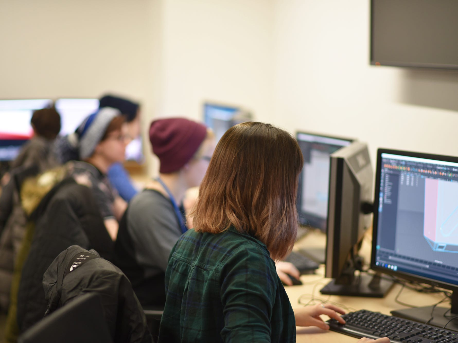 Students at Champlain College sit in one of the Game Design classrooms creating objects in digital space on March 5, 2019. Students said to think of it as carpentry or even set building within a computer program. First you have to create objects, then you put them together to build an environment. Then comes light and texture and color.