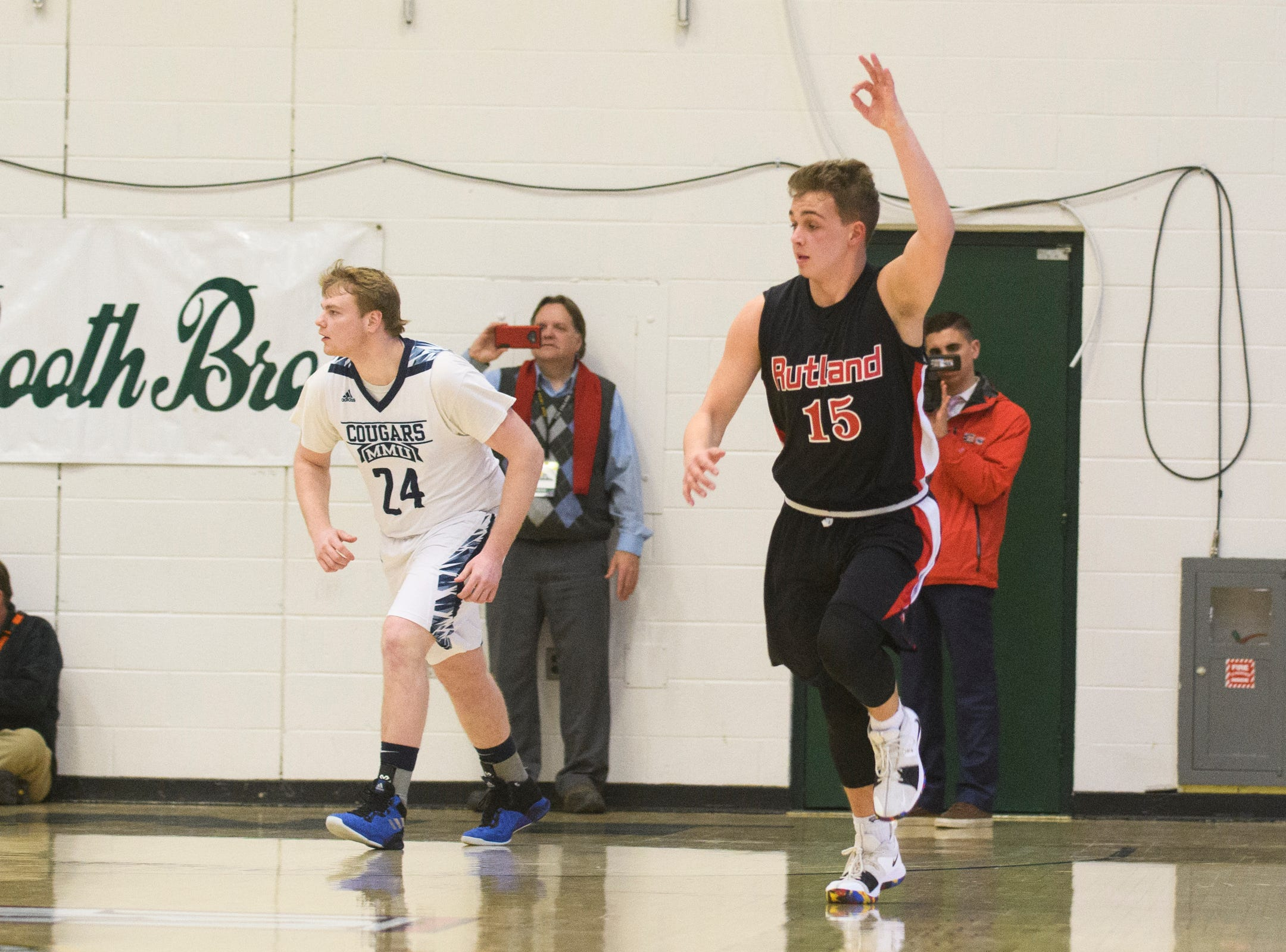 Rutland's Ethan Notte (15) celebrates after making a three pointer during the boys DI semi final basketball game between the Rutland Raiders and the Mount Mansfield Cougars at Patrick Gym on Monday night March 11, 2019 in Burlington, Vermont.