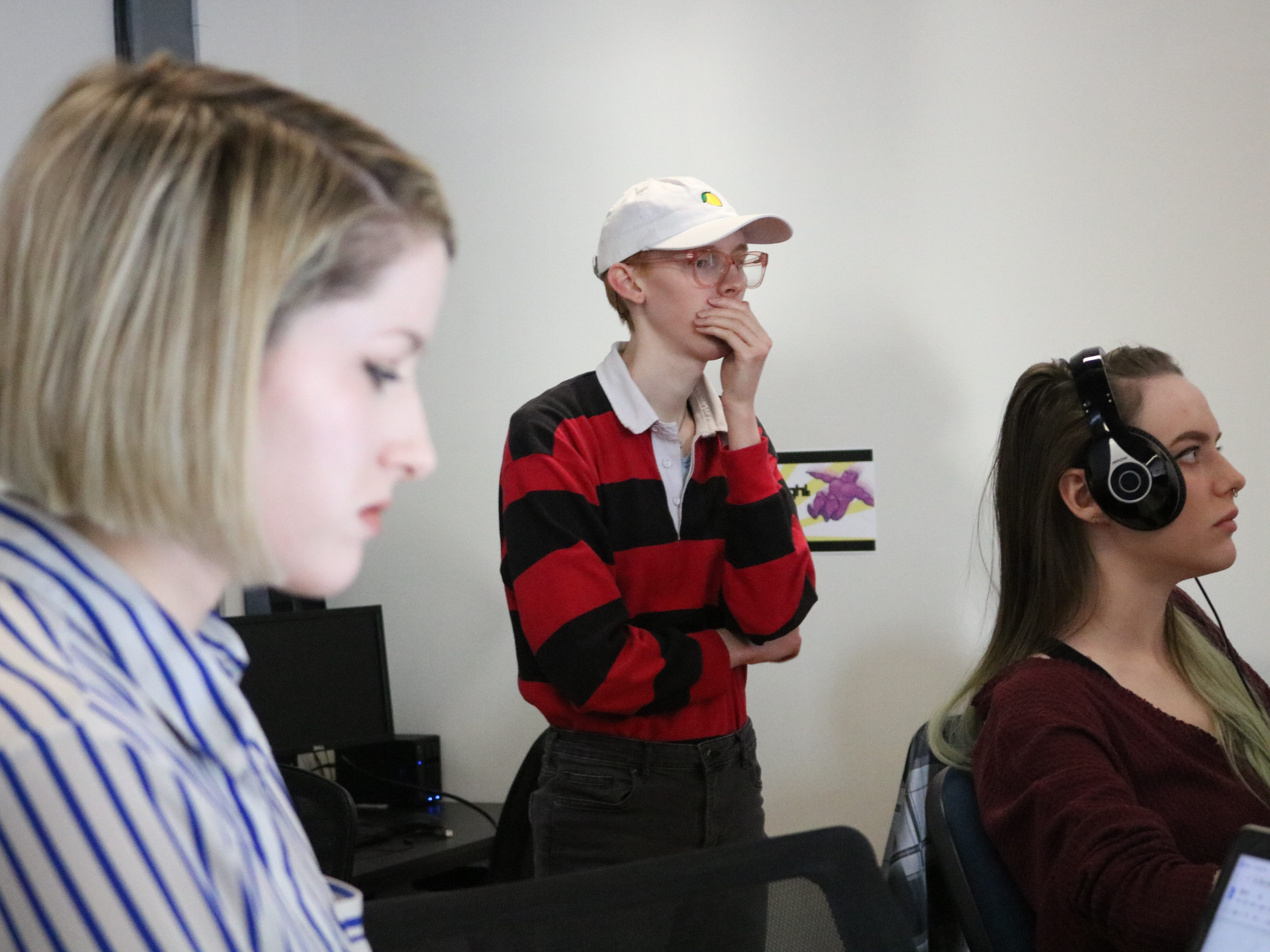 Shannon Mitchell of Game Theory in the foreground with two other game builders who share a co-working space at Chace Mill in Burlington. There were a mix of genders and racial diversity in the space, which is not typical of the industry, according to statistics.