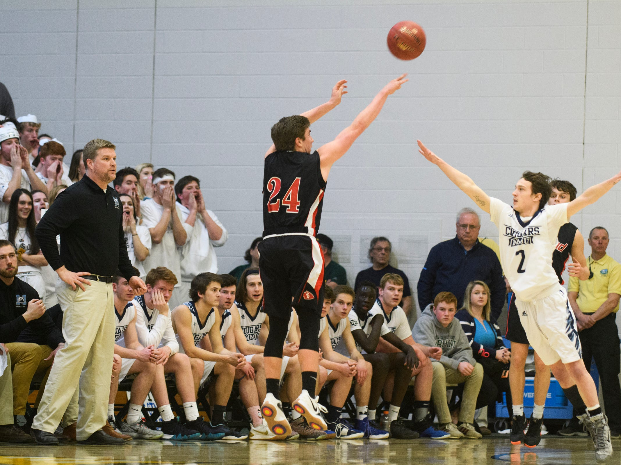 Rutland's Jacob Lorman (24) shoots a three pointer during the boys DI semi final basketball game between the Rutland Raiders and the Mount Mansfield Cougars at Patrick Gym on Monday night March 11, 2019 in Burlington, Vermont.