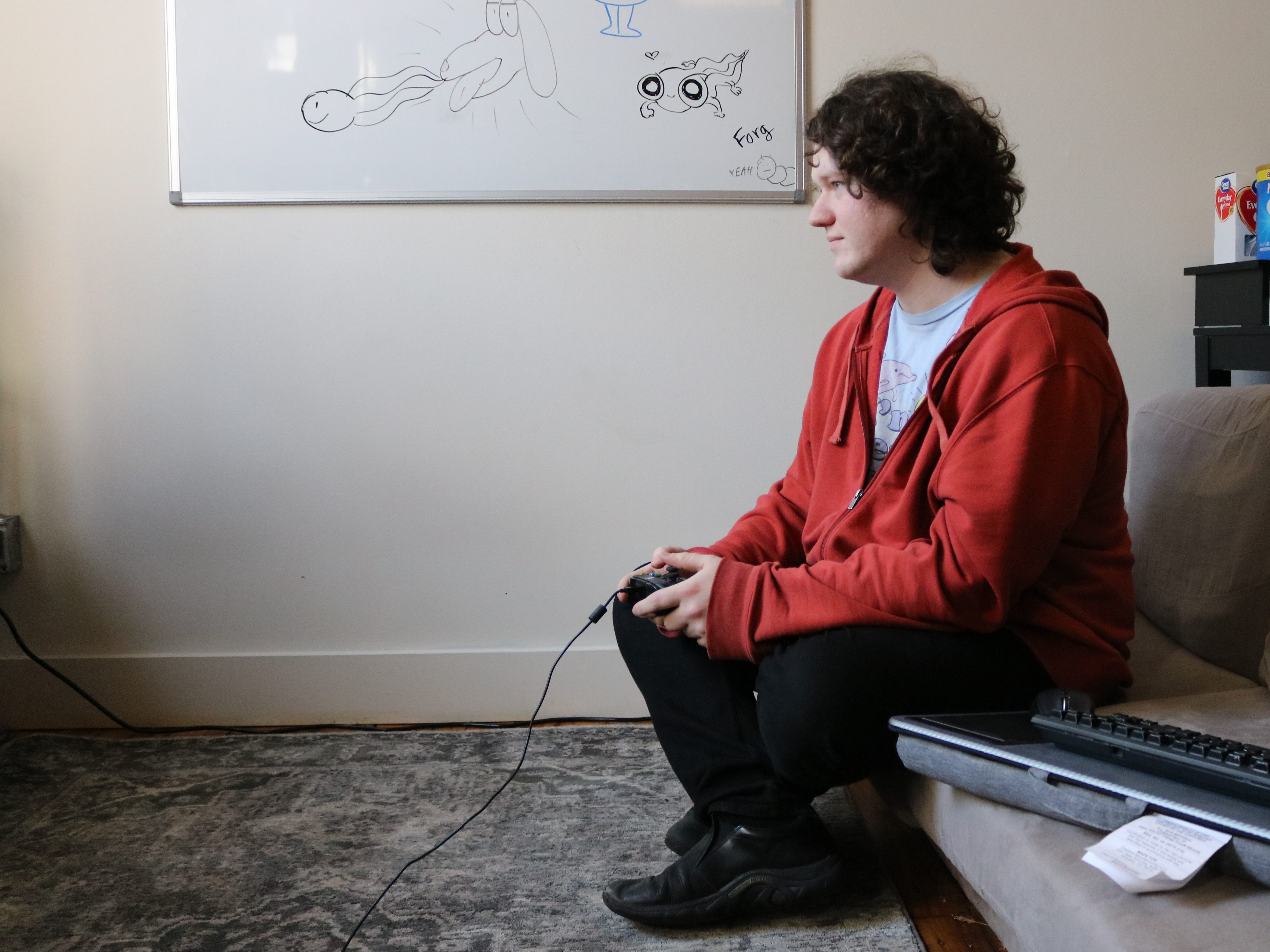Fisher Wagg, 23, shows how Dad Quest, a game created by Sundae Month, is played. Wagg works for Sundae Month, but also has his own company, Feeler.Farm.