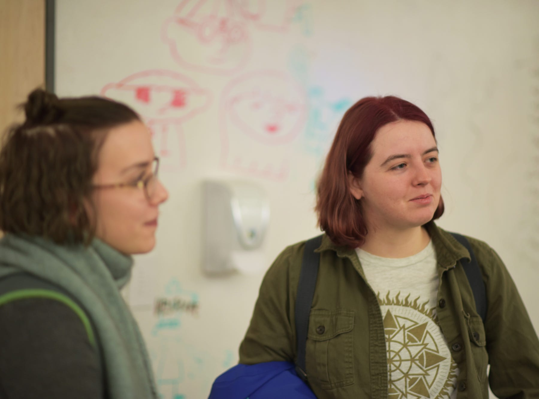 Amila Nuhodzic, 27, of Burlington,  stands in the foreground with Jennifer Carlin, 22, of Hyattsville, Maryland. Carlin accepted an offer to join Insomniac Games in Burbank, California to work on Marvel's Spider-Man for PS4. She follows three alumni to Insomniac including: Charlie Carucci '18, Colton Orr '18 and Zach Bohn '12.
