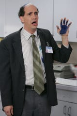 "Sam Lloyd as Ted Buckland, the head of the legal affairs department, in a scene from the television show ""Scrubs."""