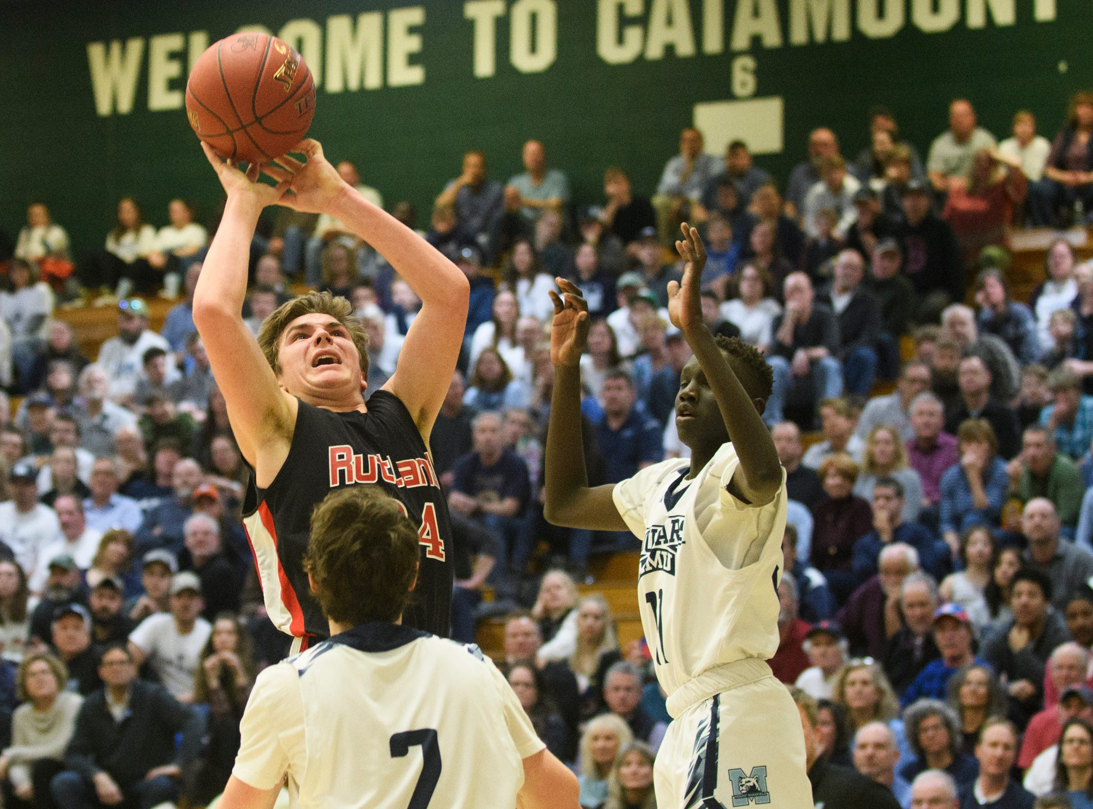 Rutland's Jacob Lorman (24) leaps to take a shot during the boys DI semi final basketball game between the Rutland Raiders and the Mount Mansfield Cougars at Patrick Gym on Monday night March 11, 2019 in Burlington, Vermont.