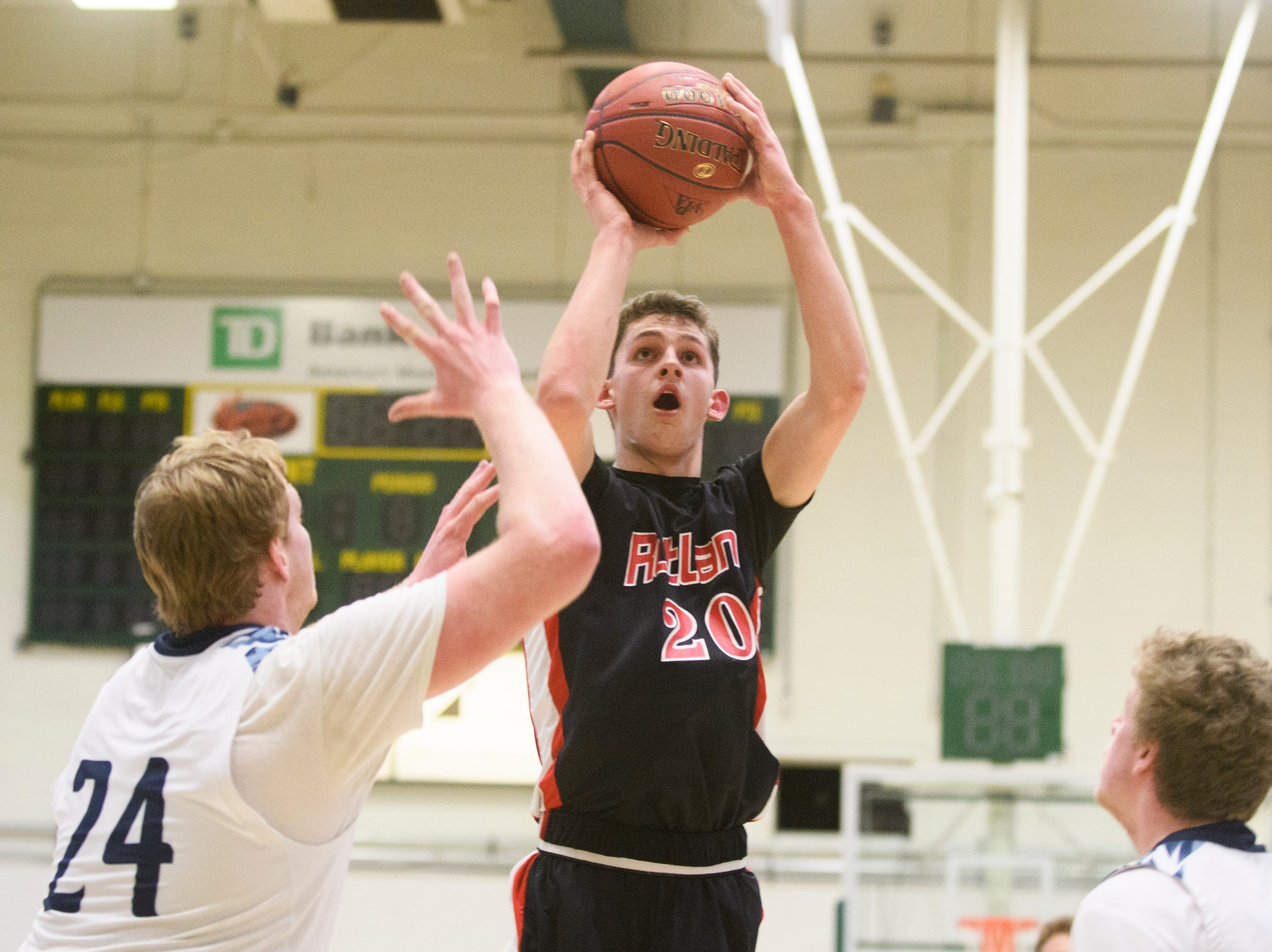 Rutland's Eric Coughlin (20) during the boys DI semi final basketball game between the Rutland Raiders and the Mount Mansfield Cougars at Patrick Gym on Monday night March 11, 2019 in Burlington, Vermont.