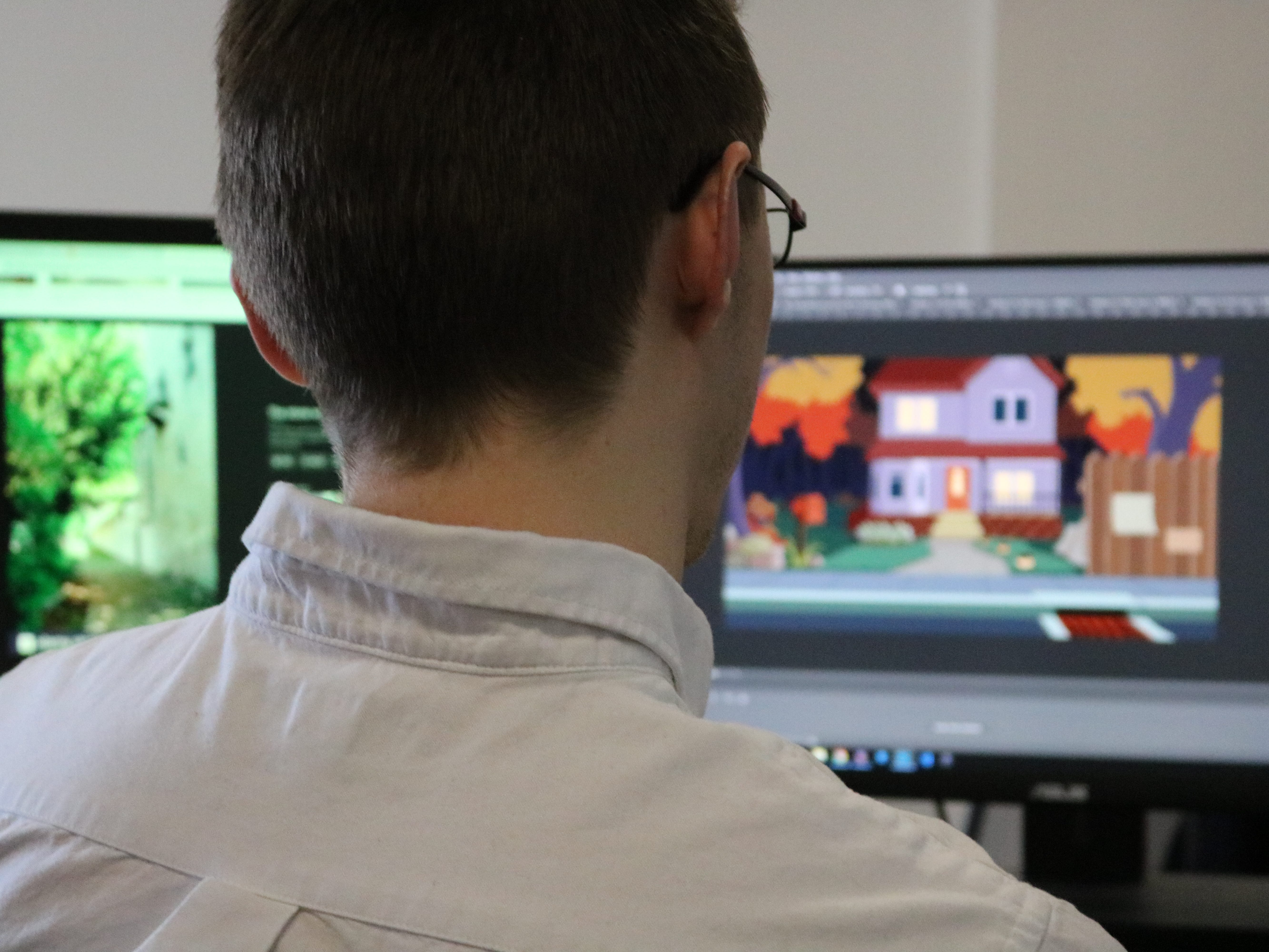 Double screens are the standard in game design studios. This Sundae Month employee at Chase Mill in Burlington, shows off some animation that may become part of a game.